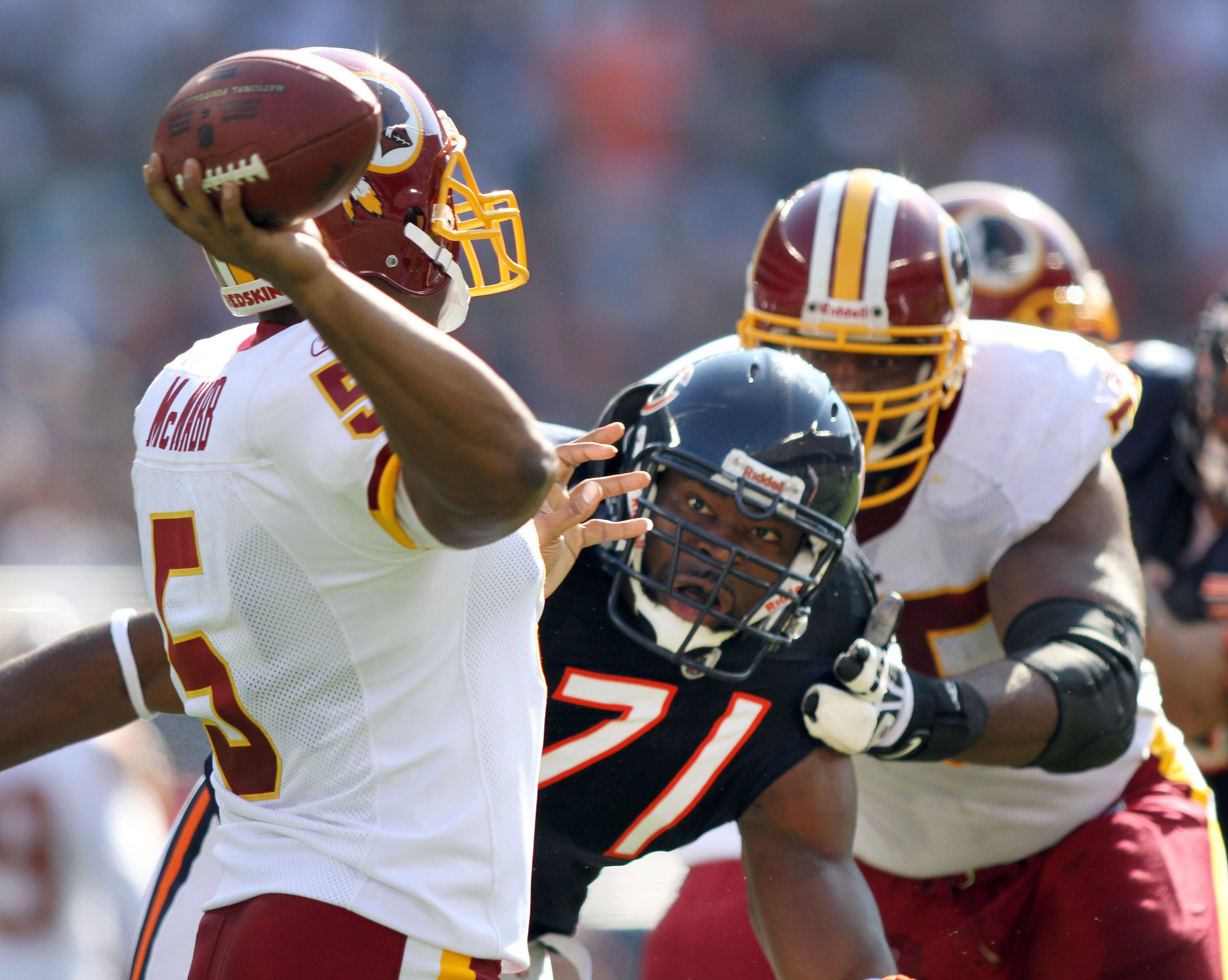 Bears defensive end Israel Idonije puts pressure on Redskins quarterback Donovan McNabb earlier this season.