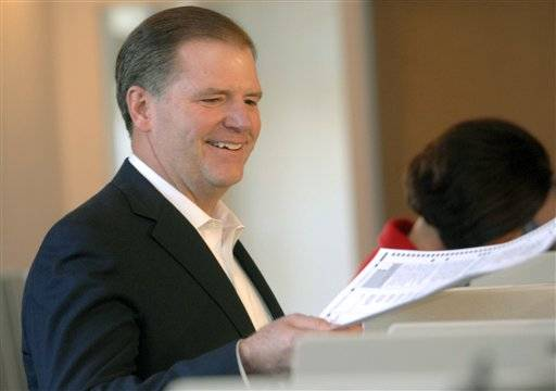 Republican gubernatorial candidate Bill Brady, returns a ballot after mistakenly being given two ballots, prior to voting Tuesday.