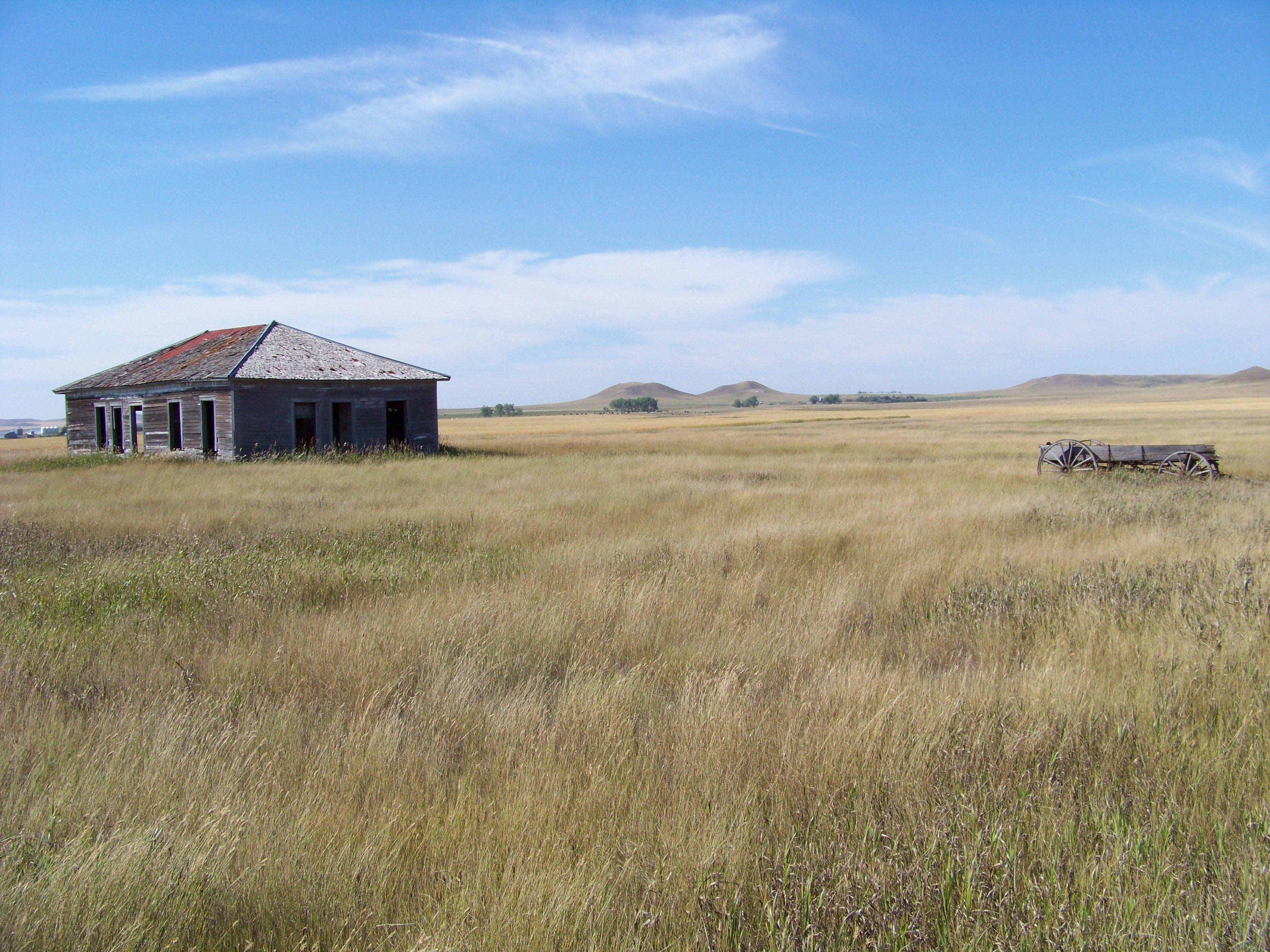 An old house sits in the middle of a prairie seen during a road trip to North Dakota in 2009.