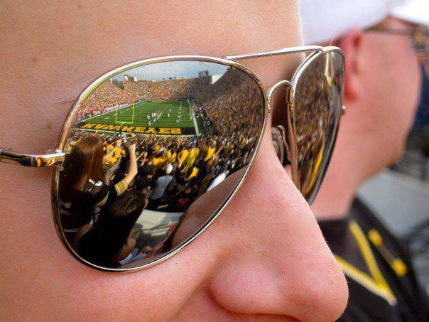 Sunglasses reflect the action on the field during the University Of Iowa against the University Of Wisconsin football game last month in Iowa City.
