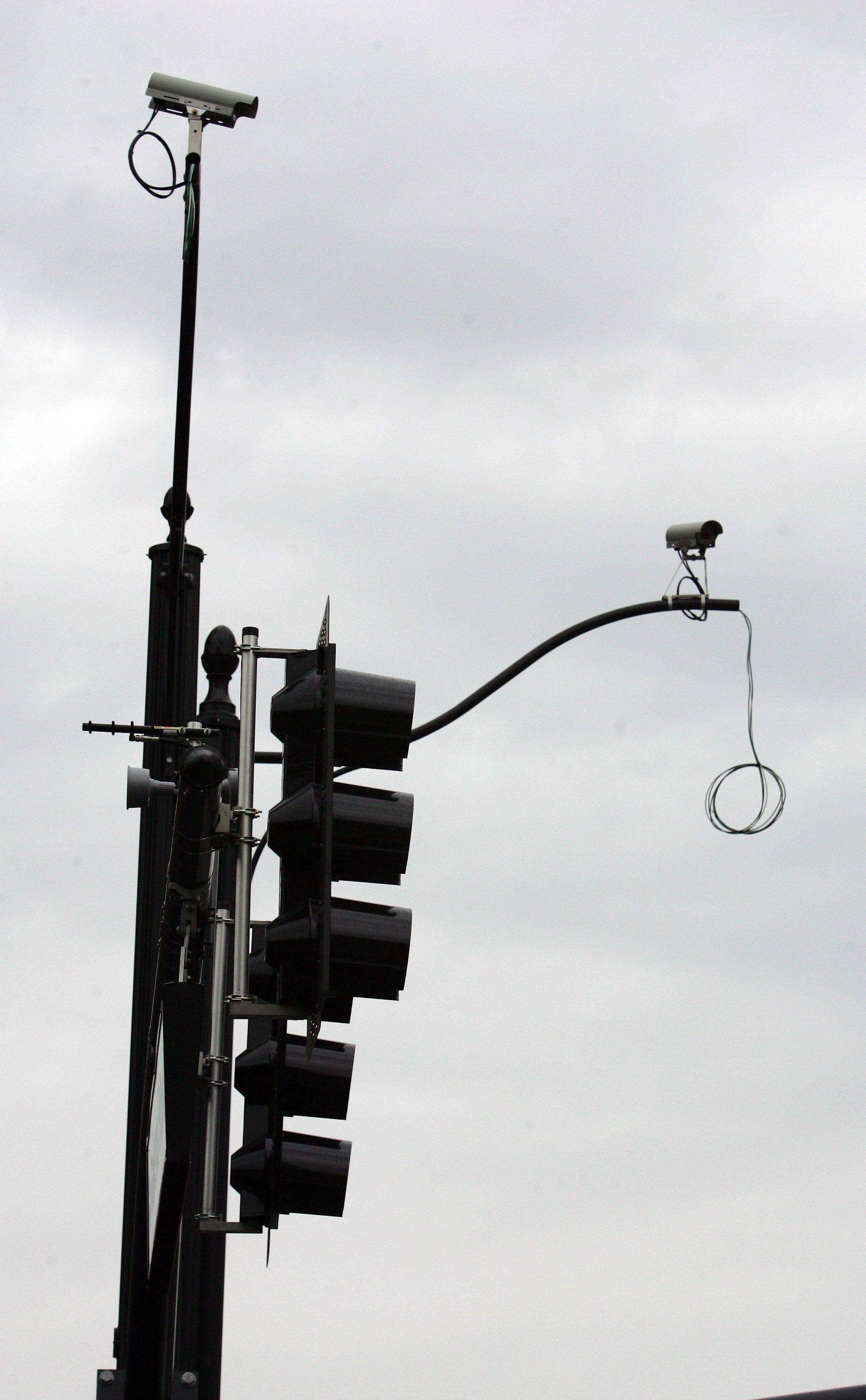 New traffic signals like this one being installed in Aurora include traffic monitoring cameras and control boxes that allow city staff to change the signal remotely from a traffic control center in city hall.