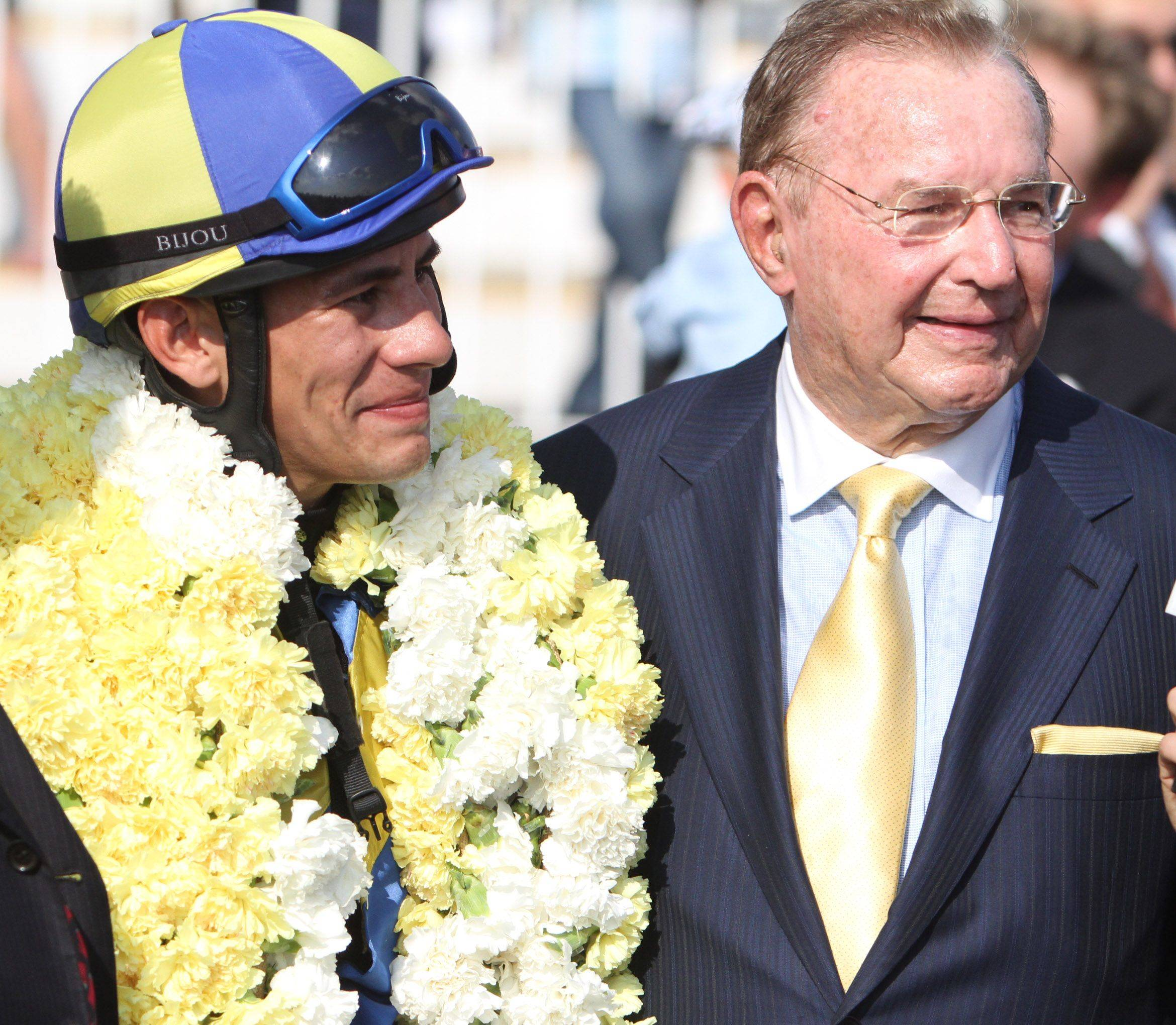 Jockey Junior Alvarado with owner Richard Duchossois after winning The Beverly D. stakes with Éclair de Lune at Arlington Park. The Arlington Park filly will race Friday in the Breeders' Cup Filly & Mare Turf at Churchill Downs.