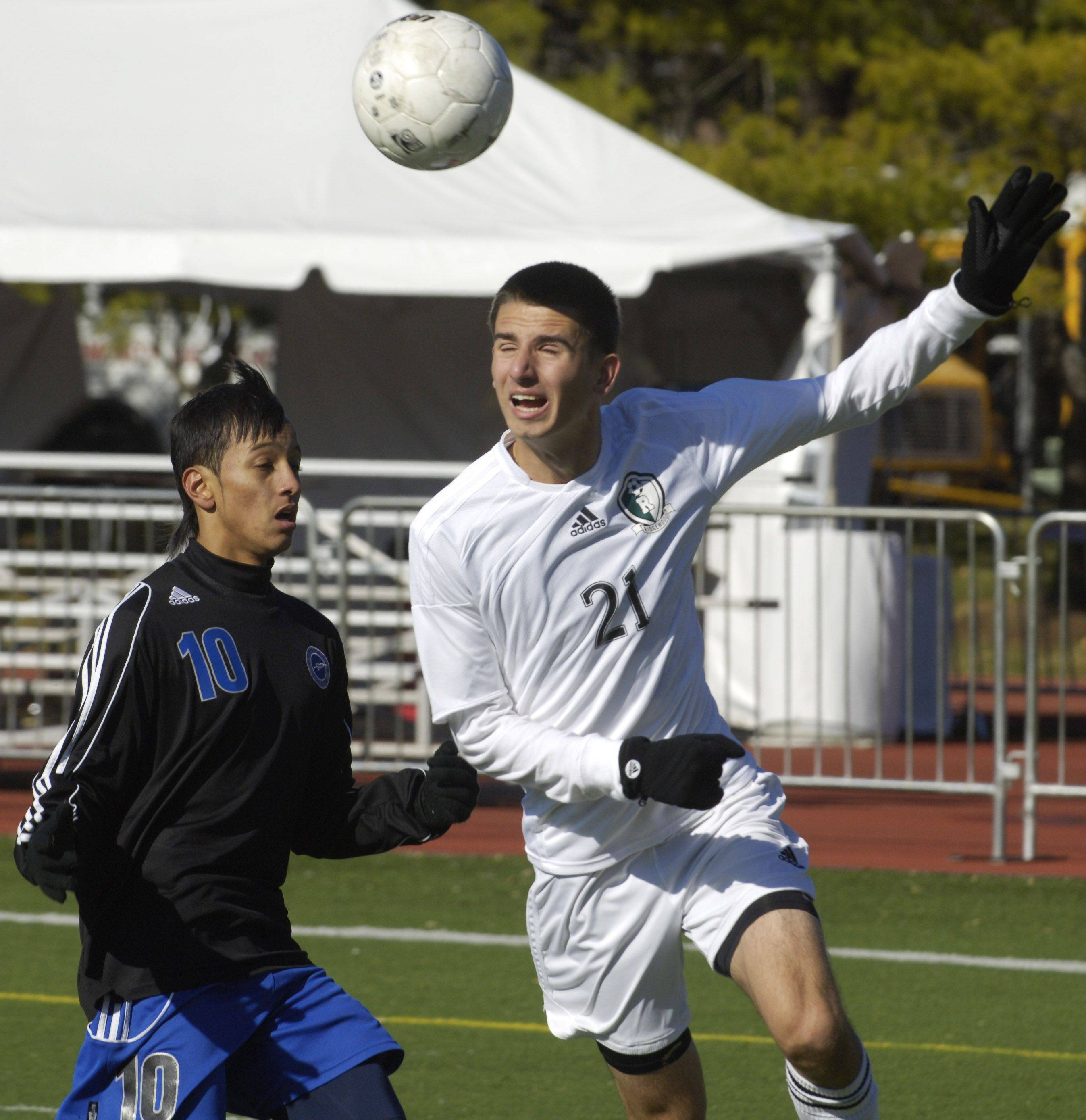 Irvin Grepo of Ridgewood, right, tries to direct the ball past Burlington Central's Alexis Camarena.