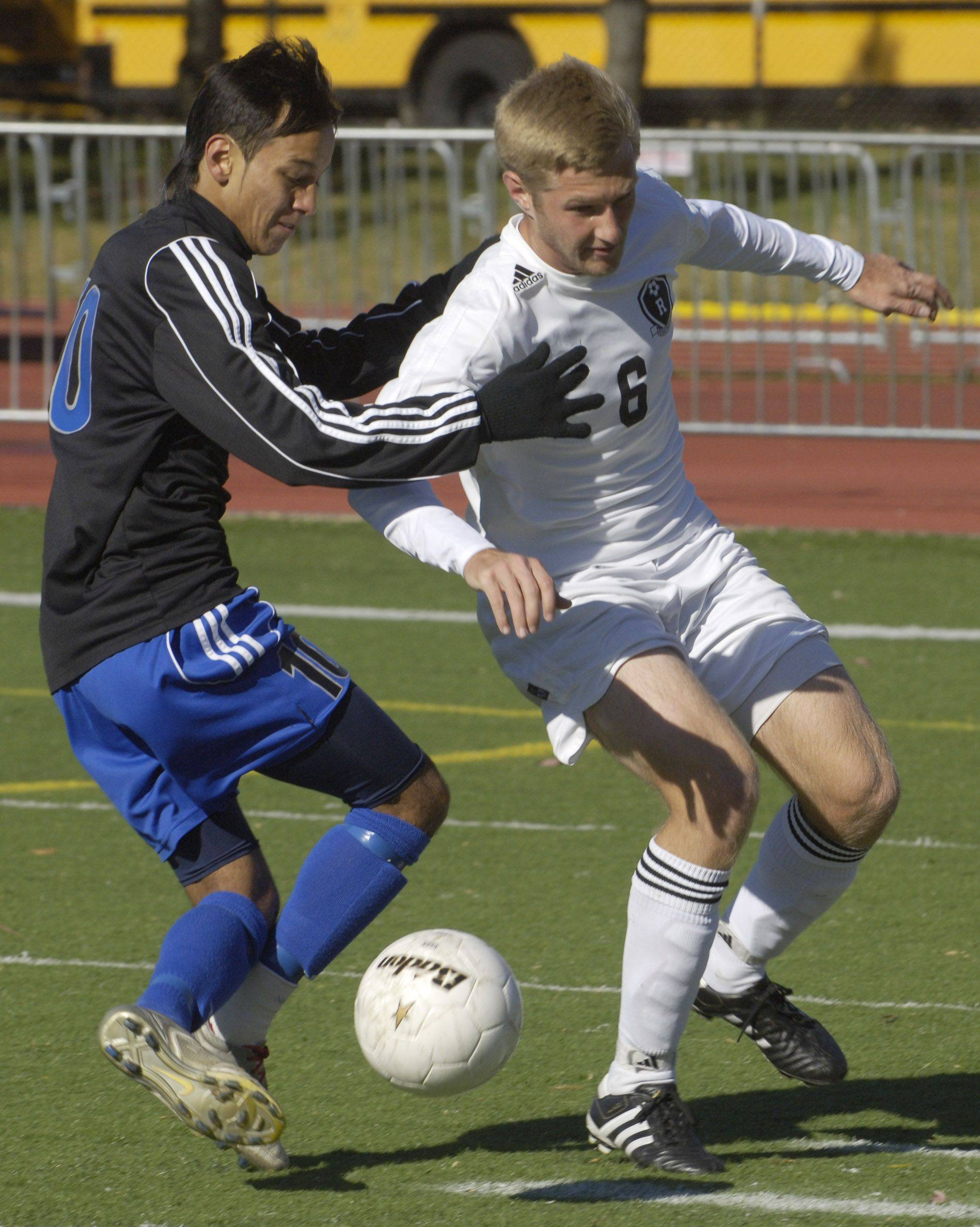 Alexis Camarena of Burlington Central, left, makes contact with Mike Kuczek of Ridgewood.