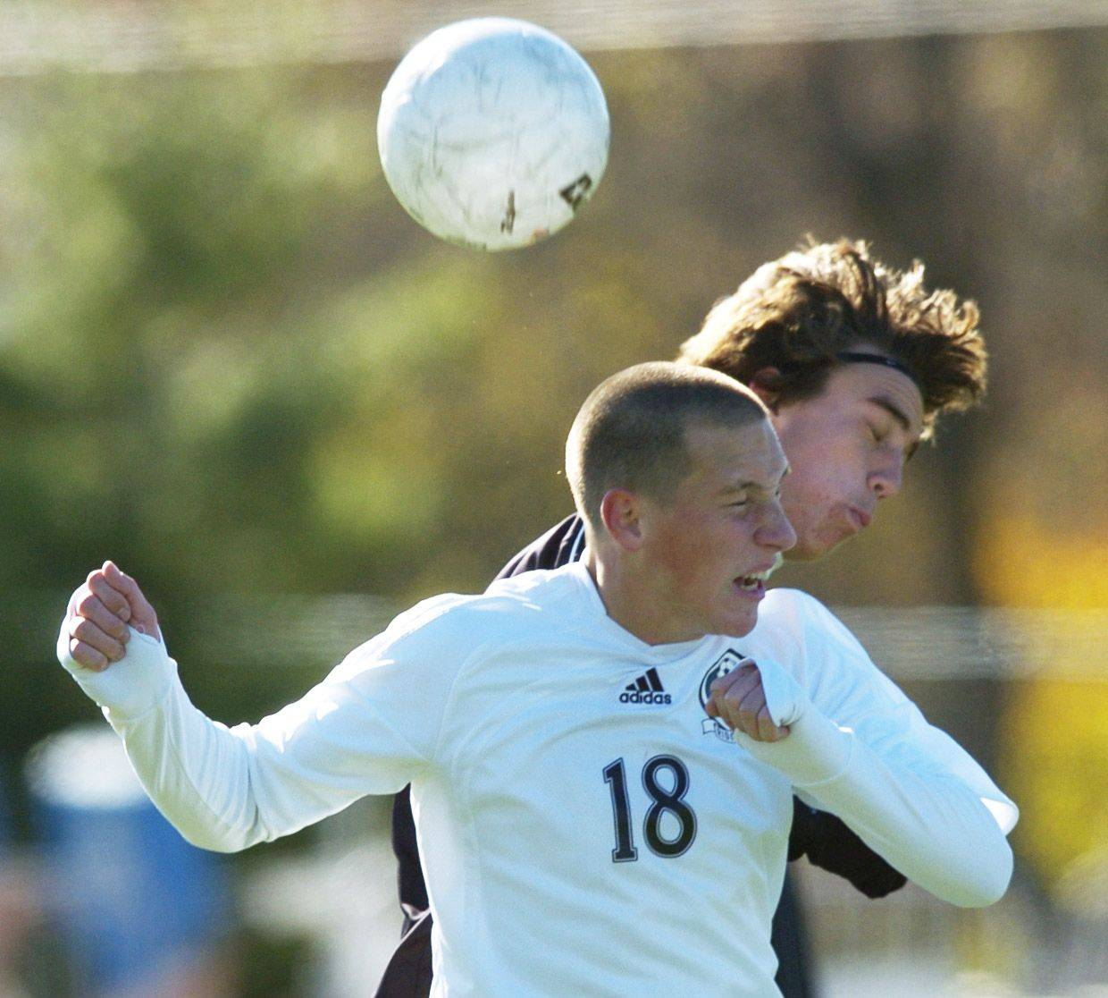 Mario Siembida of Ridgewood, front, and Kyle Reopelle of Burlington Central leap for a header.