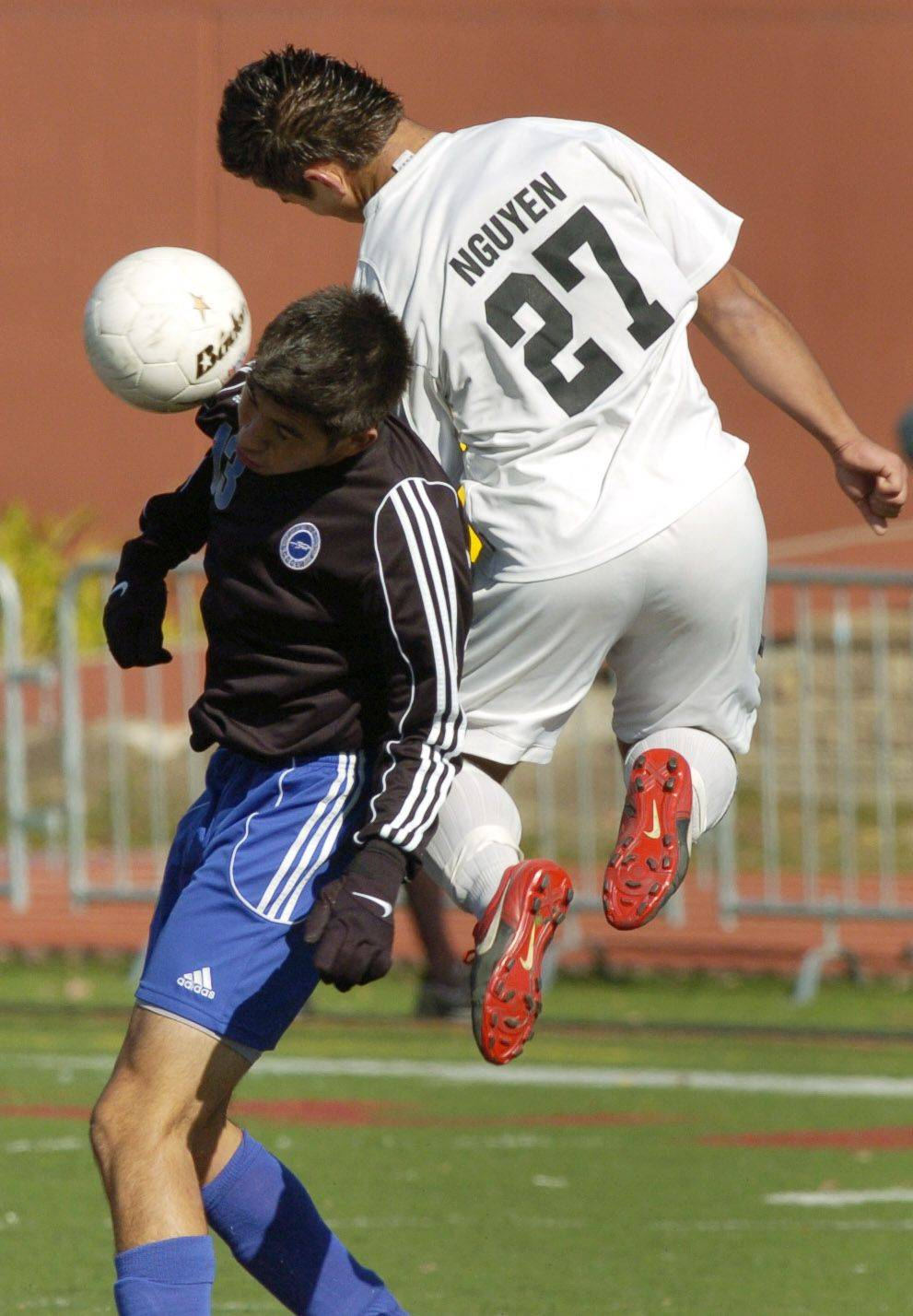Burlington Central's Erick Uribe, left, and Ridgewood's Maciej Nguyen make contact.