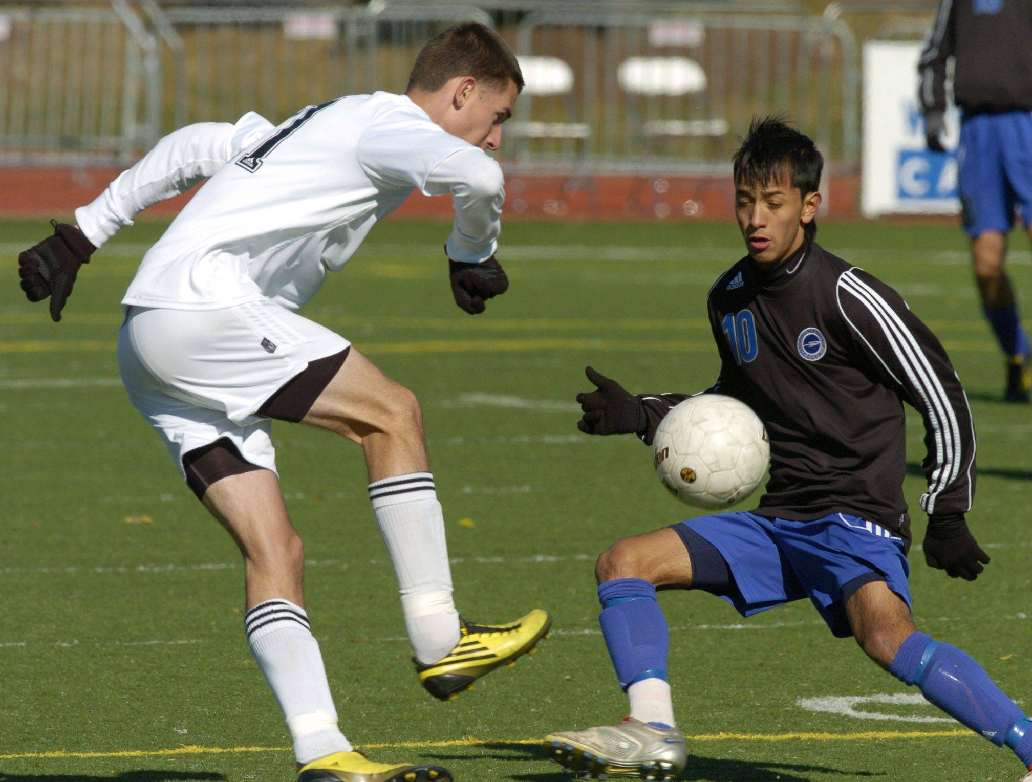 Ridgewood's Irvin Grepo kicks the ball past Burlington Central's Alexis Camarena.