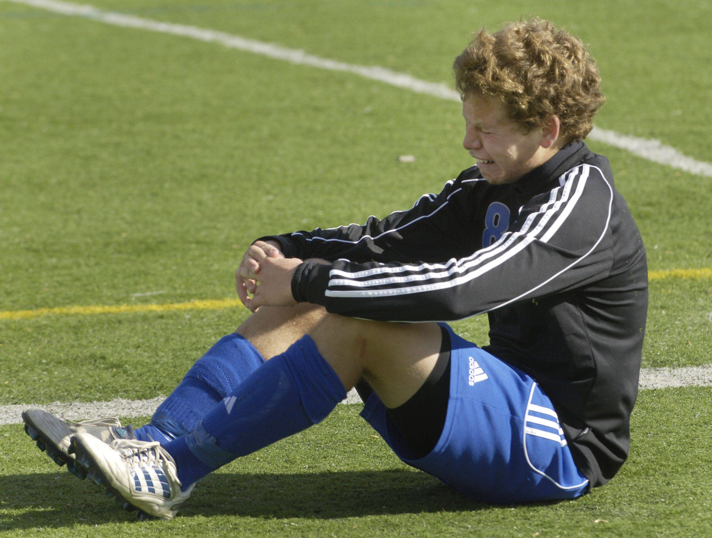 Christopher Gousios of Burlington Central reacts after a loss to Ridgewood.