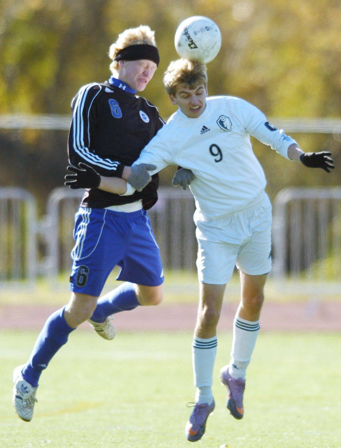 Burlington Central's Zachary Jochum, left, and Ridgewood's Peter Soja leap for a header.