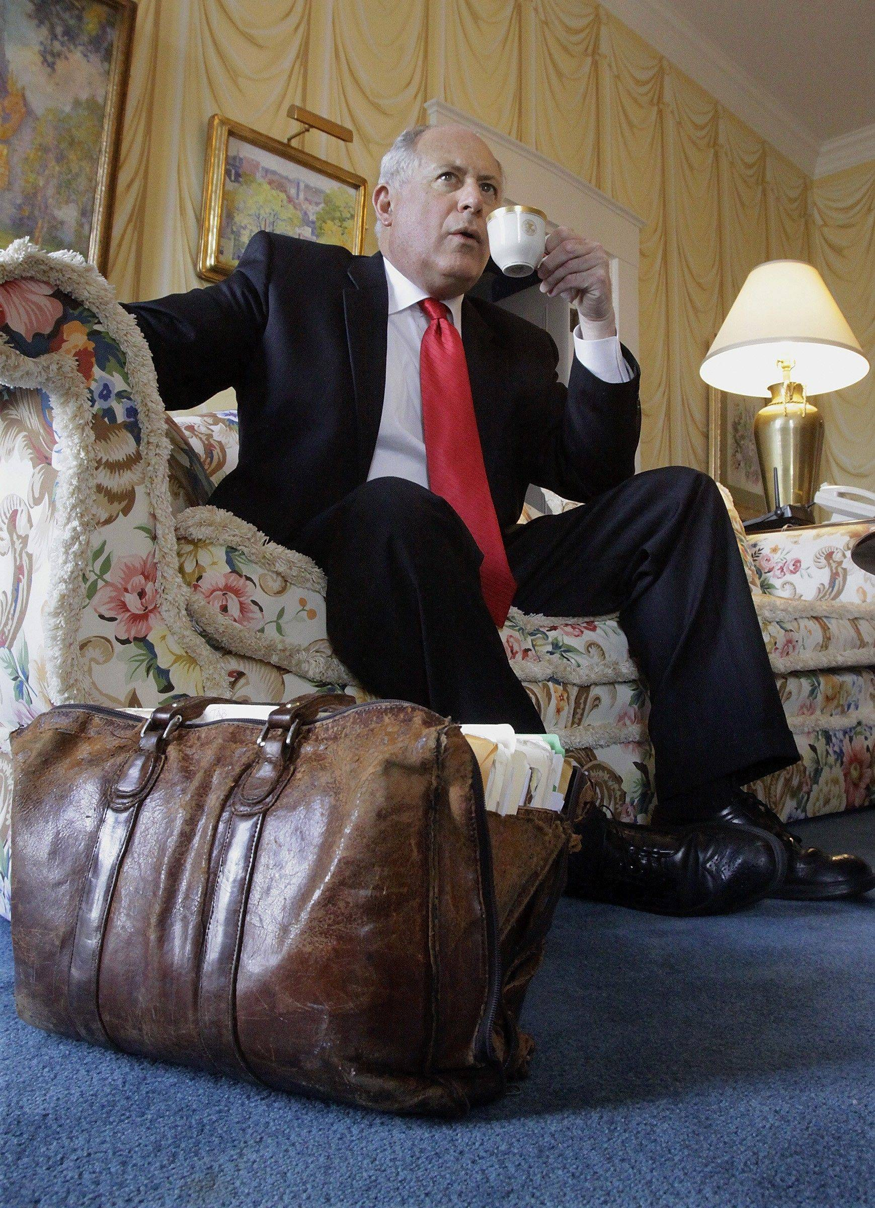 "Illinois Gov. Pat Quinn has tea in the living room of the Executive Mansion in Springfield, Ill., Thursday, March, 26, 2009. His almost 30-year-old briefcase ""Betsy"" sits on the floor. After six years as lieutenant governor, Quinn is leaning on his well-honed image of honest public servant as he leads Illinois government in the wake of the corruption scandal that engulfed his predecessor and fellow Democrat Gov. Rod Blagojevich."