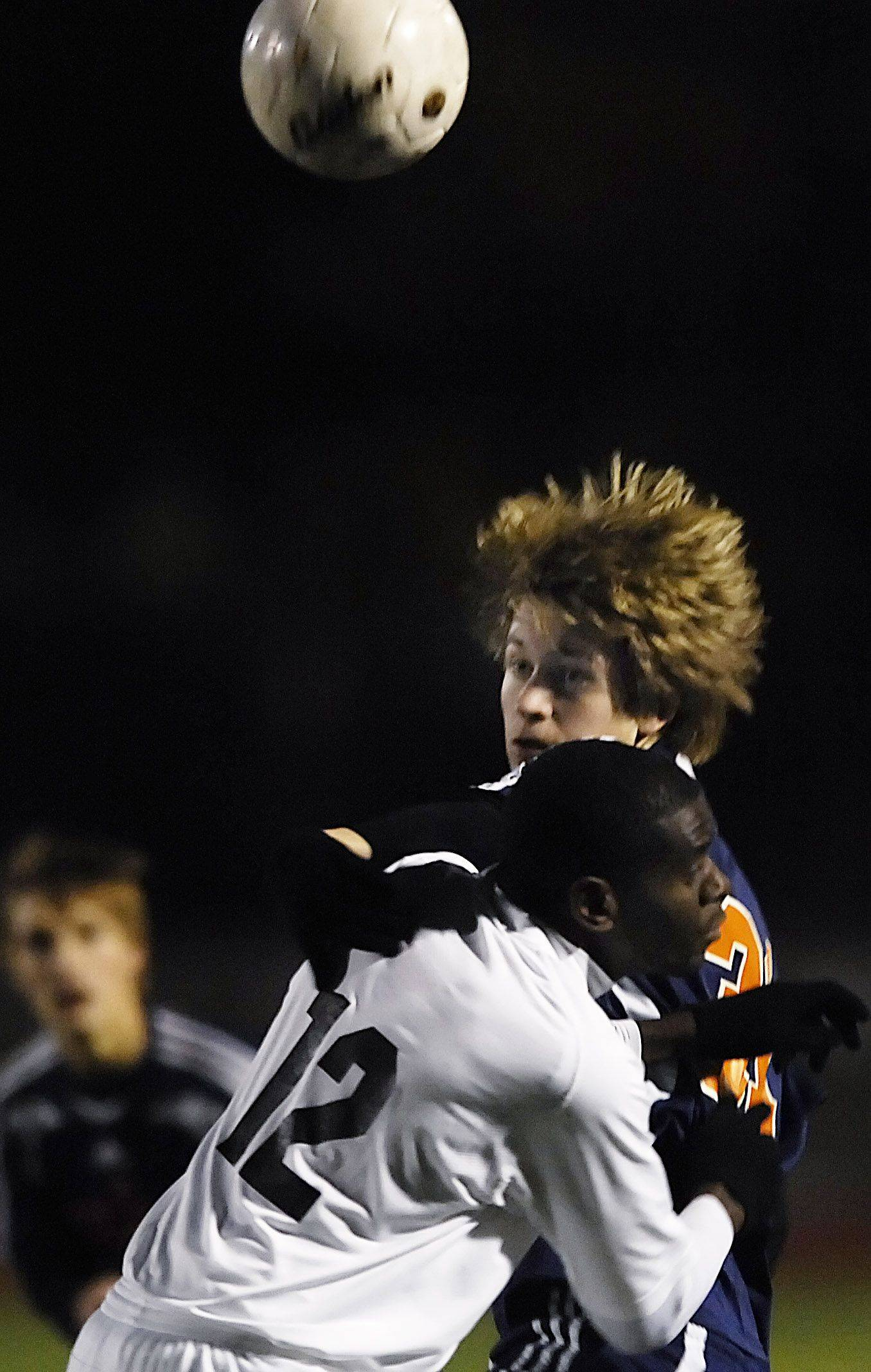 Naperville North's Kyle Lindberg and Edwardsville's Peter Renken compete for a header in the state tournament in Naperville Saturday.