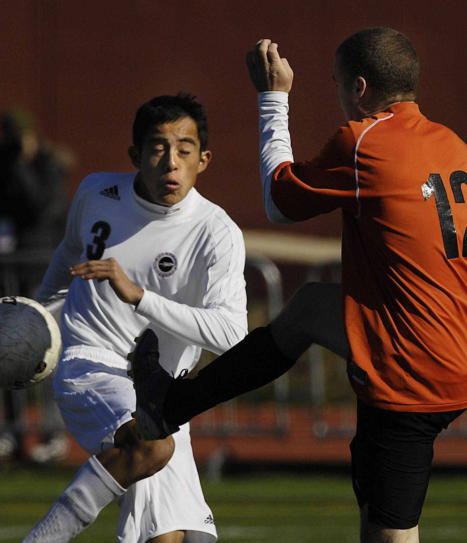 Burlington Central's Abelardo Castillo avoids the kick of Waterloo's Andrew Polacek in the third place game of the state tournament in Naperville Saturday.