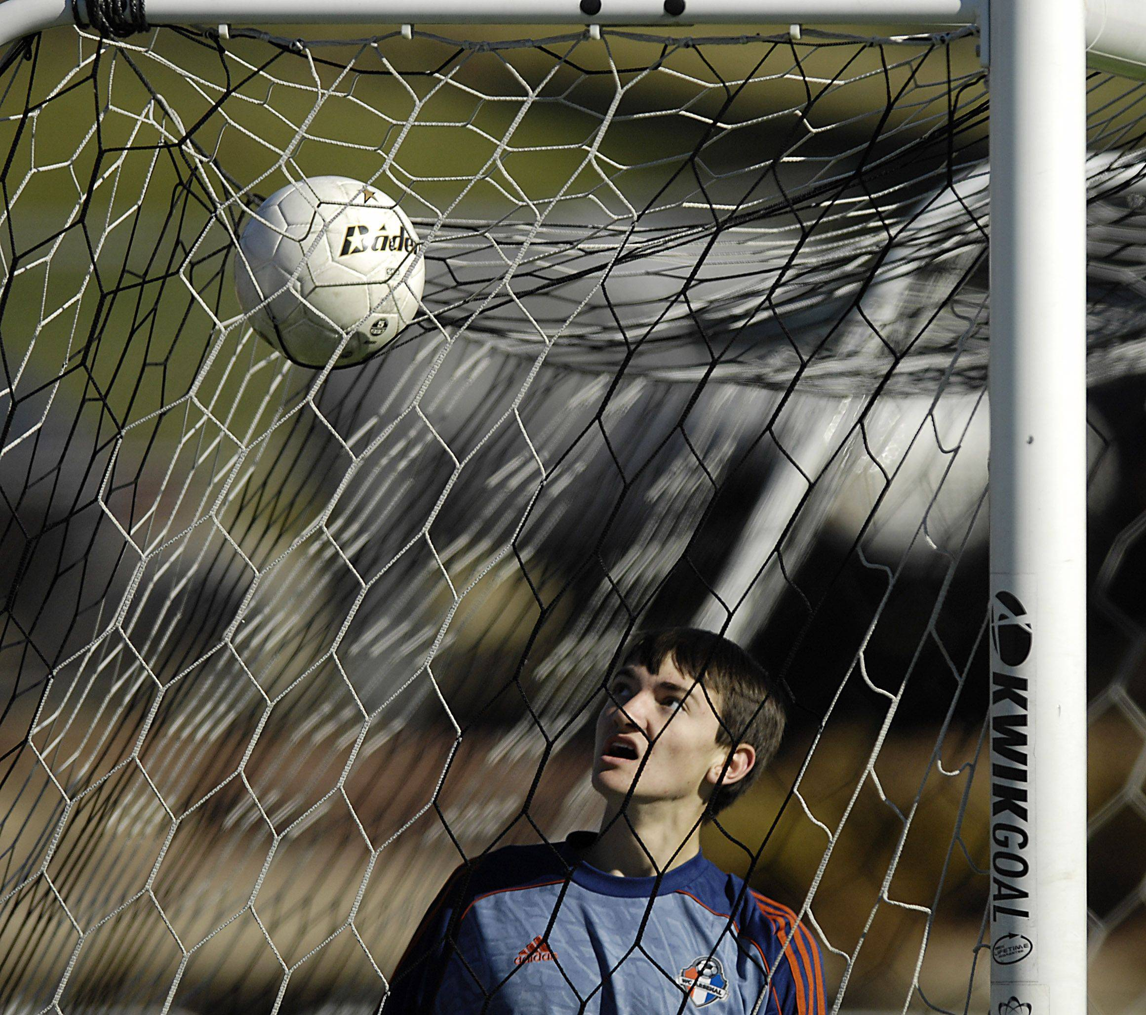 Waterloo goalkeeper Evan Blechle looks at where a Burlington Central shot landed in the third place game of the state tournament in Naperville Saturday.