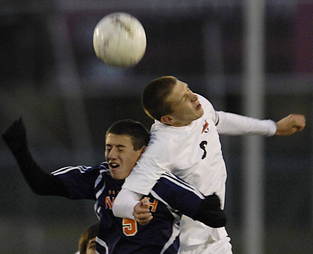 Naperville North's Joe Sullivan and Edwardsville's Patrick Dowd head the ball in the state tournament in Naperville Saturday. Naperville North came away with fourth place.