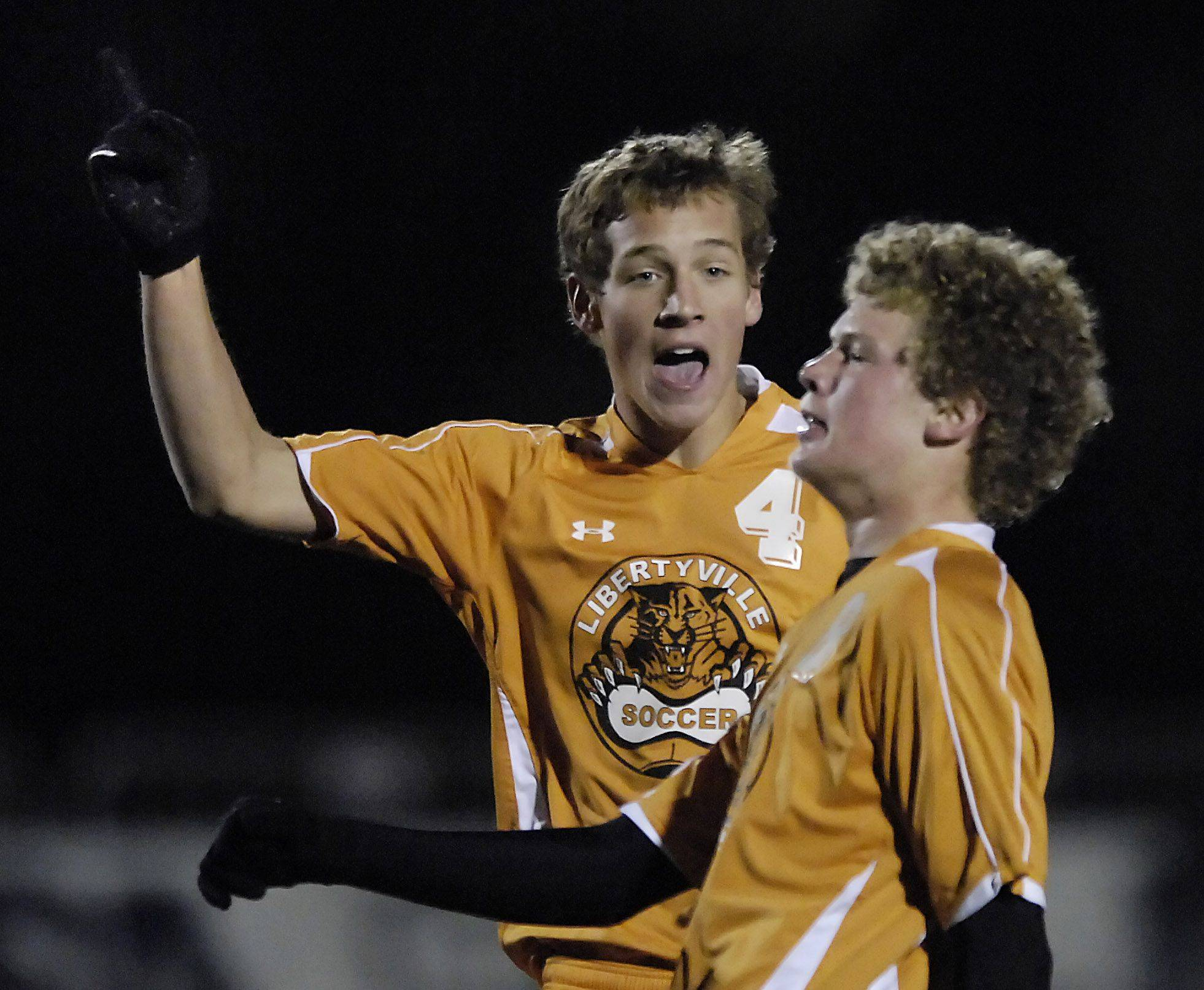 Libertyville's Miles McNeir celebrates teammate Griffin Pils' second-half goal to tie the score with Rockford Boylan in the state championship tournament in Naperville Saturday. The game went into double overtime before Boylan won.