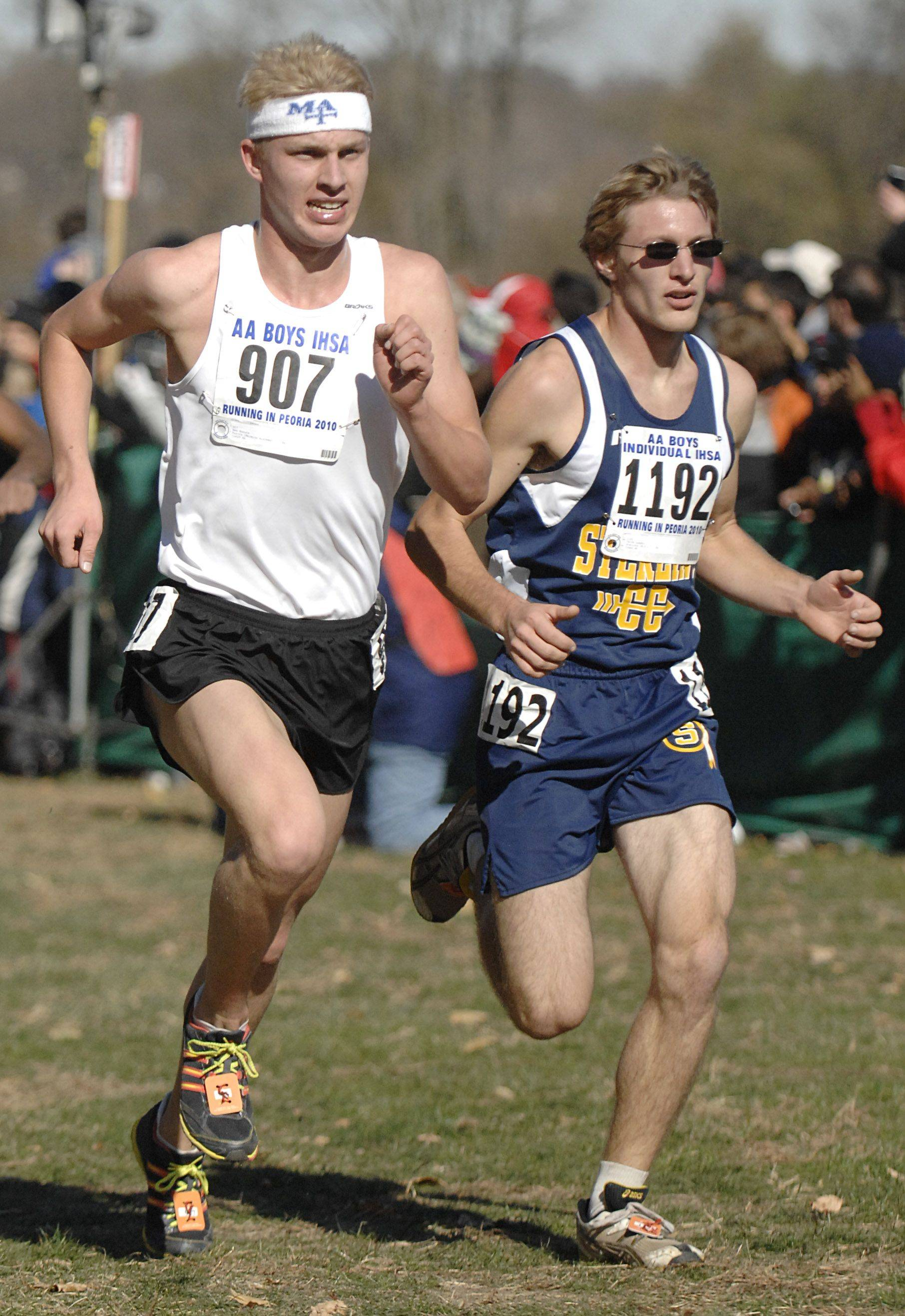 Marmion Academy's Ben Kanute, left, and Sterling's Jacob Landis fight to the finish line of the 2A class of the state cross country meet at Detweiller Park in Peoria on Saturday, November 6.