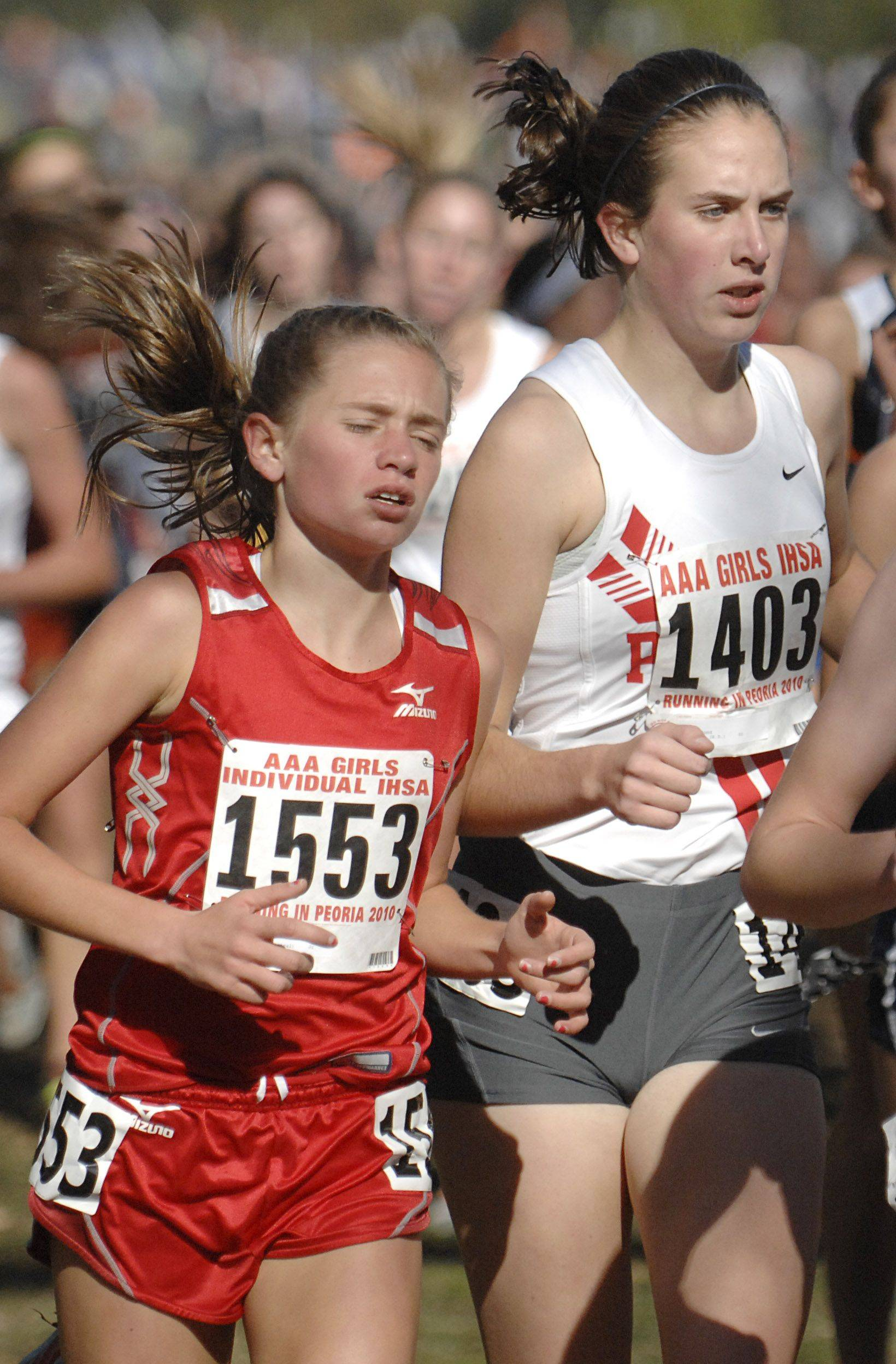 Naperville Central's Amanda Fox, left, and Palatine High School's Becca Sund in the 3A class of the state cross country meet at Detweiller Park in Peoria on Saturday, November 6.