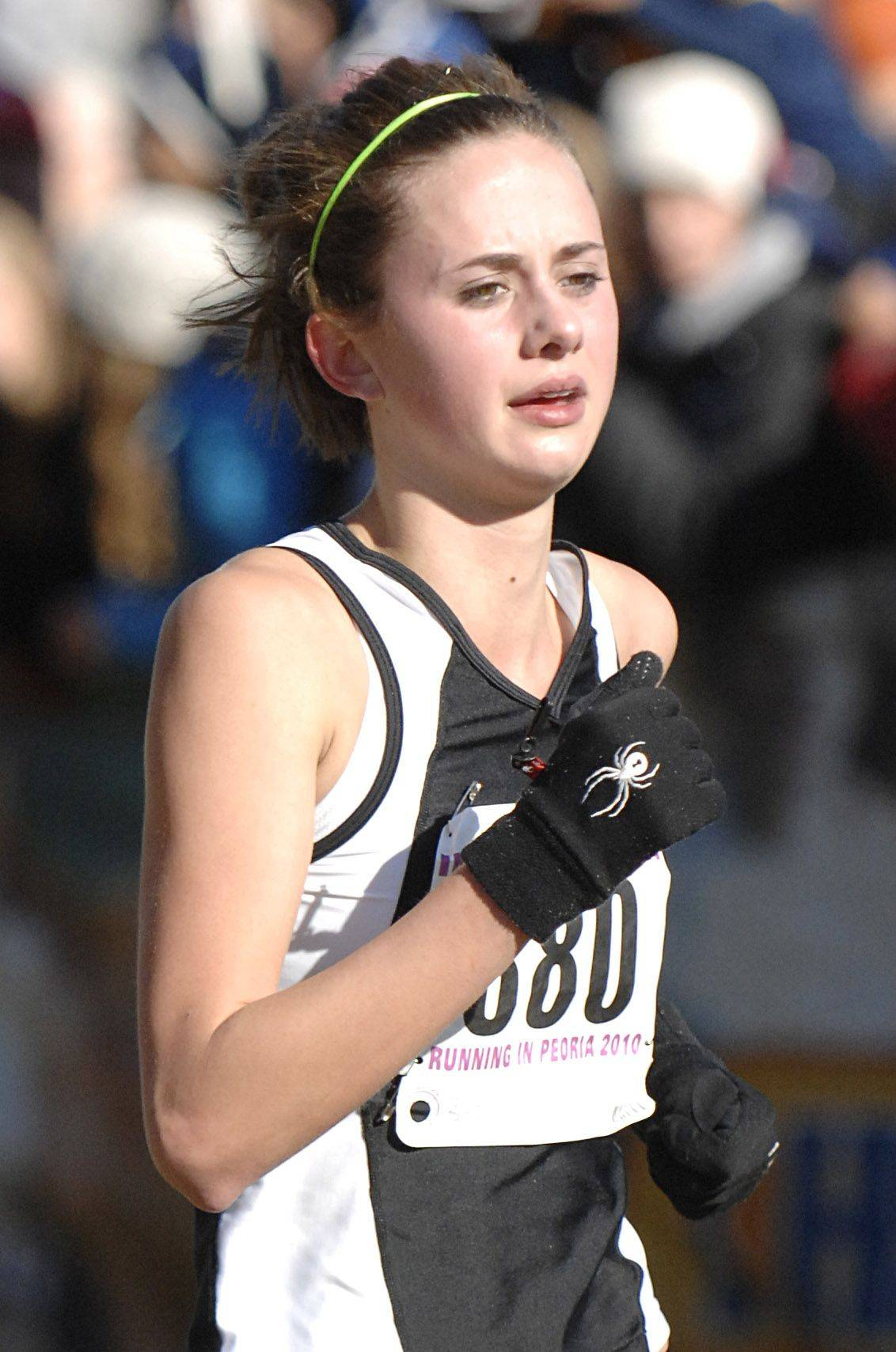 Kaneland's Jen Howland nears the 2A class finish line at the state cross country meet at Detweiller Park in Peoria on Saturday, November 6.