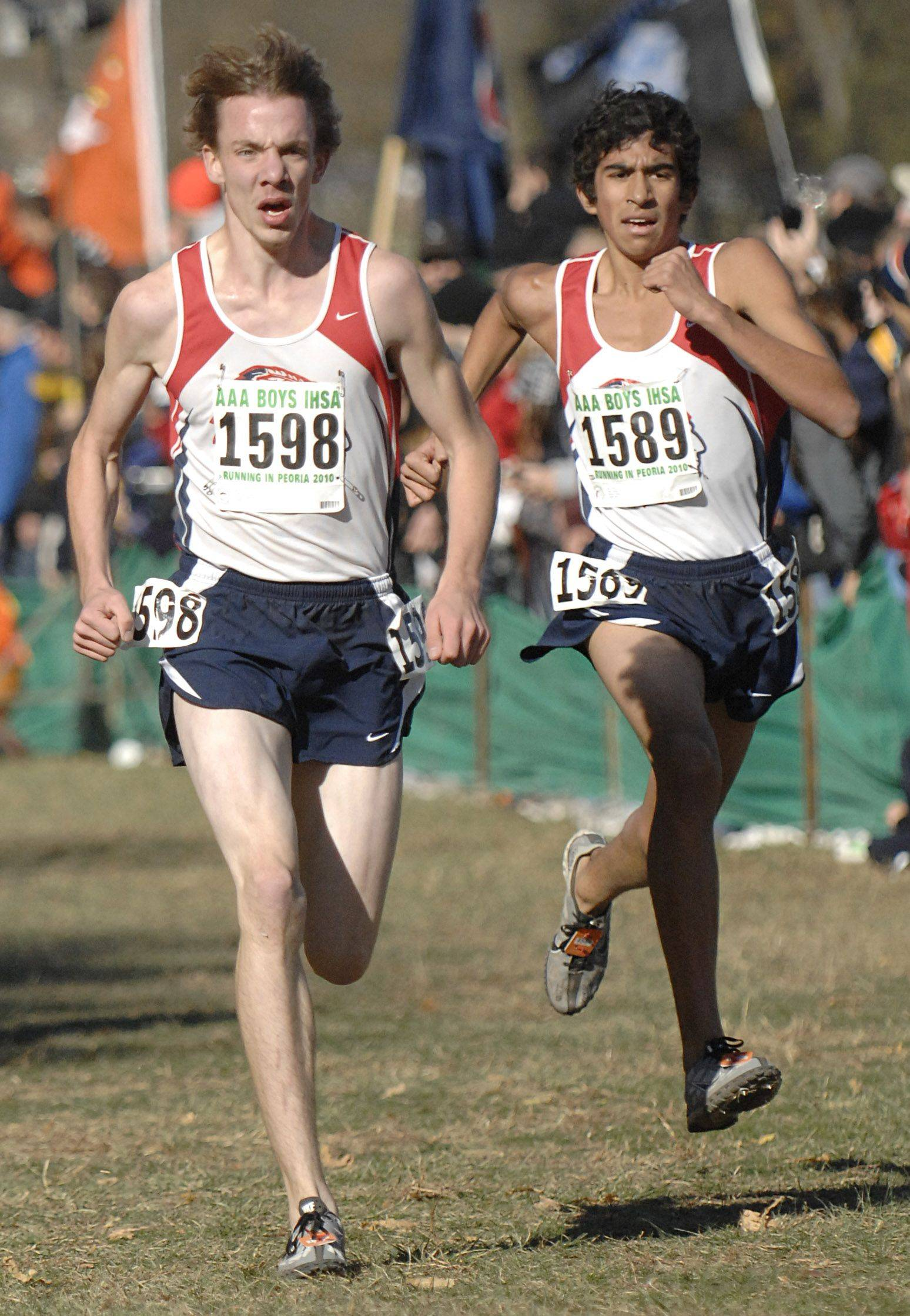 Aurora West teammates Josh Robinson and Omar Gomez near the 3A finish line of the state cross country meet at Detweiller Park in Peoria on Saturday, November 6.