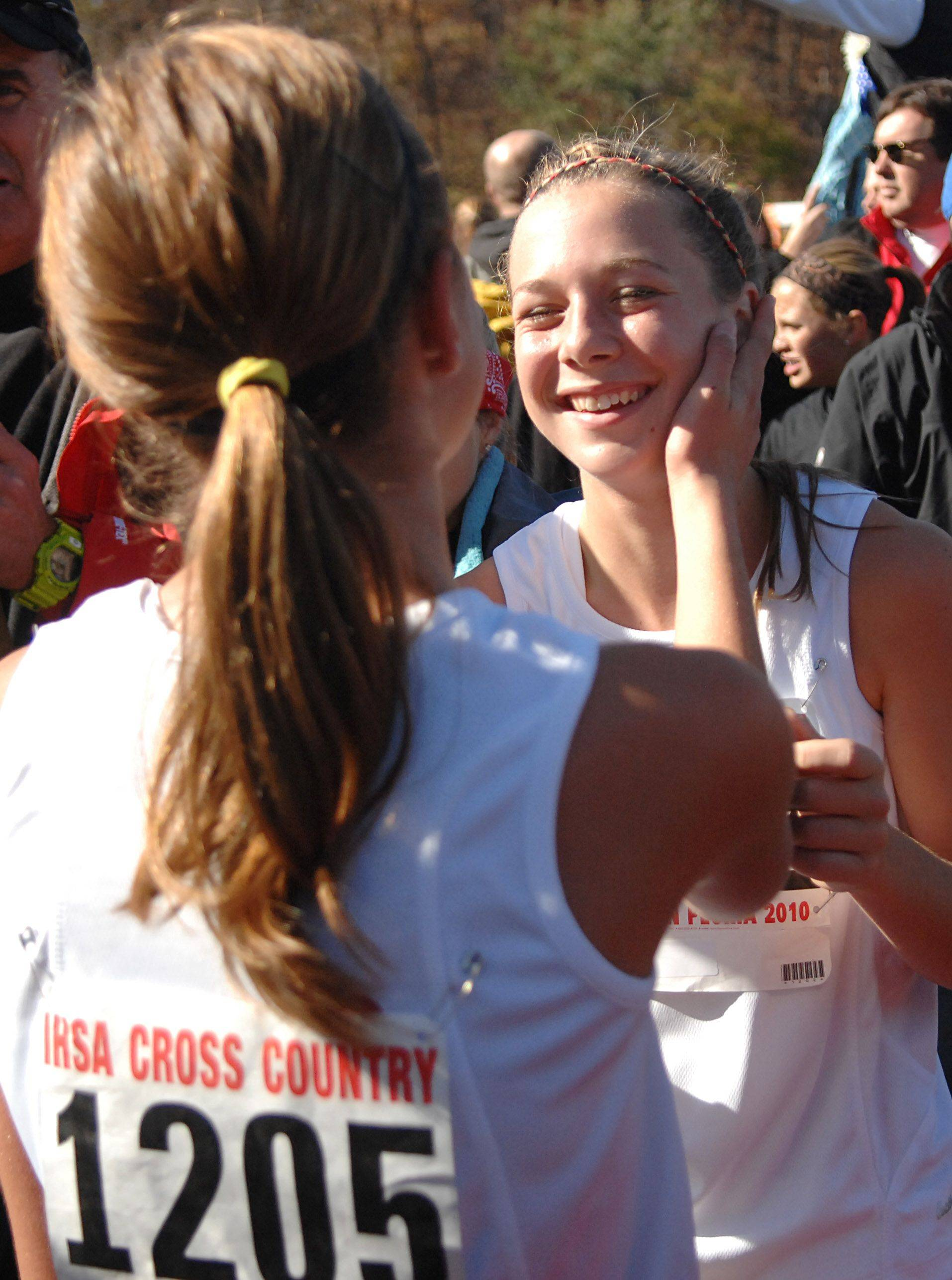 Barrington's Sarah Miller, left, and teammate Rebecca Batliner congratulate each other after the 3A class run at the state cross country state in Peoria on Saturday, November 6. Batliner took 10th place.