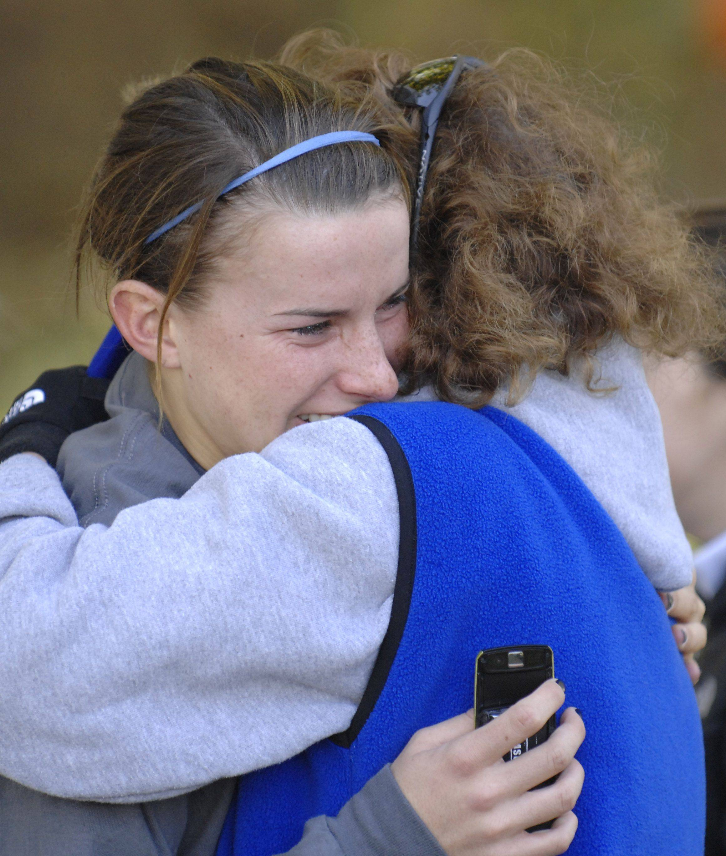 Geneva's Kelly Whitley gets a consoling hug from family friend Denise Fauntleroy after the 3A class run at the state cross country in Peoria on Saturday, November 6.