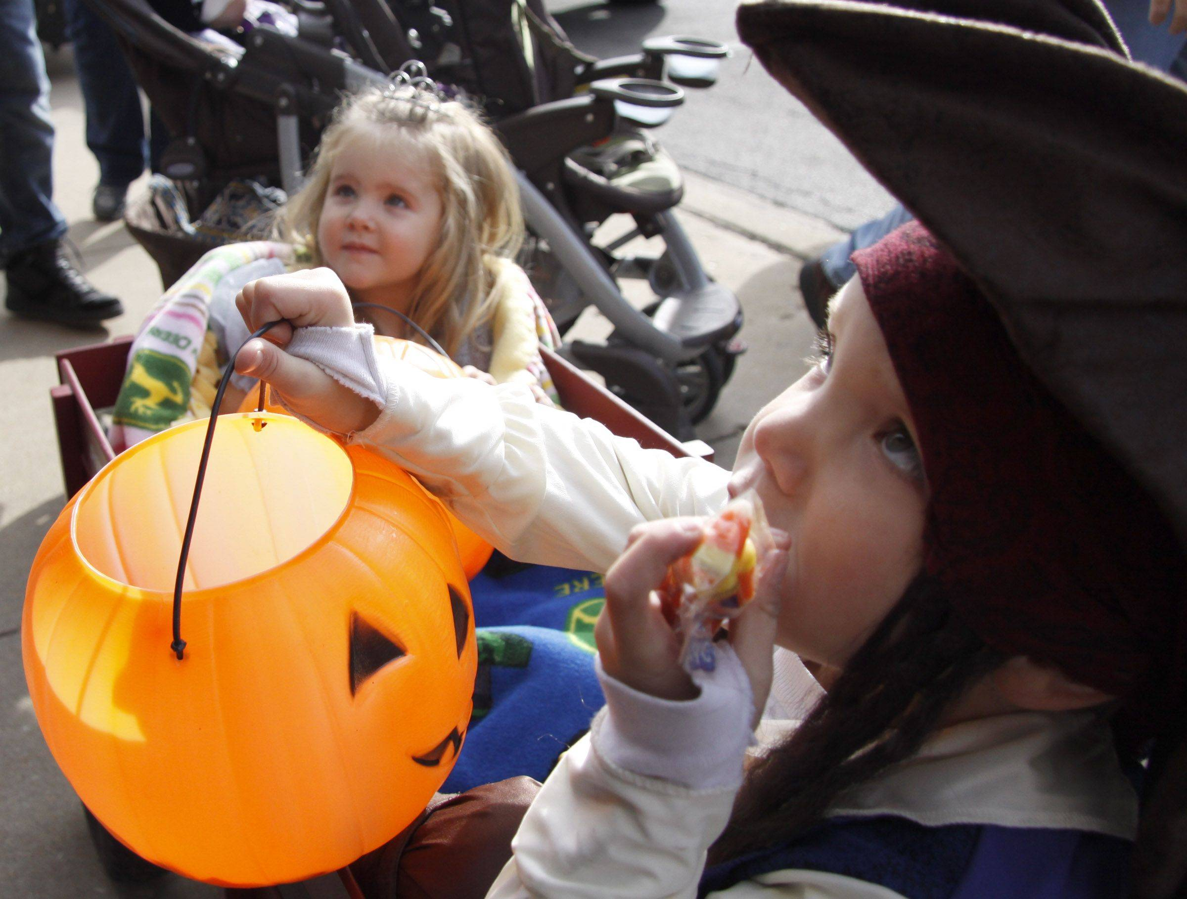 "Will Shasteen, 5, and his sister Lauren, 2, of Glen Ellyn wait to ask shop keepers for candy along the Kid's Halloween Parade route Saturday in Glen Ellyn. ""It's been going on for a long time, it's history,"" said Georgia Koch, executive director of the Chamber of Commerce in Glen Ellyn, said. ""Kids grew up doing this and probably are back bringing their own kids,"" Koch said."