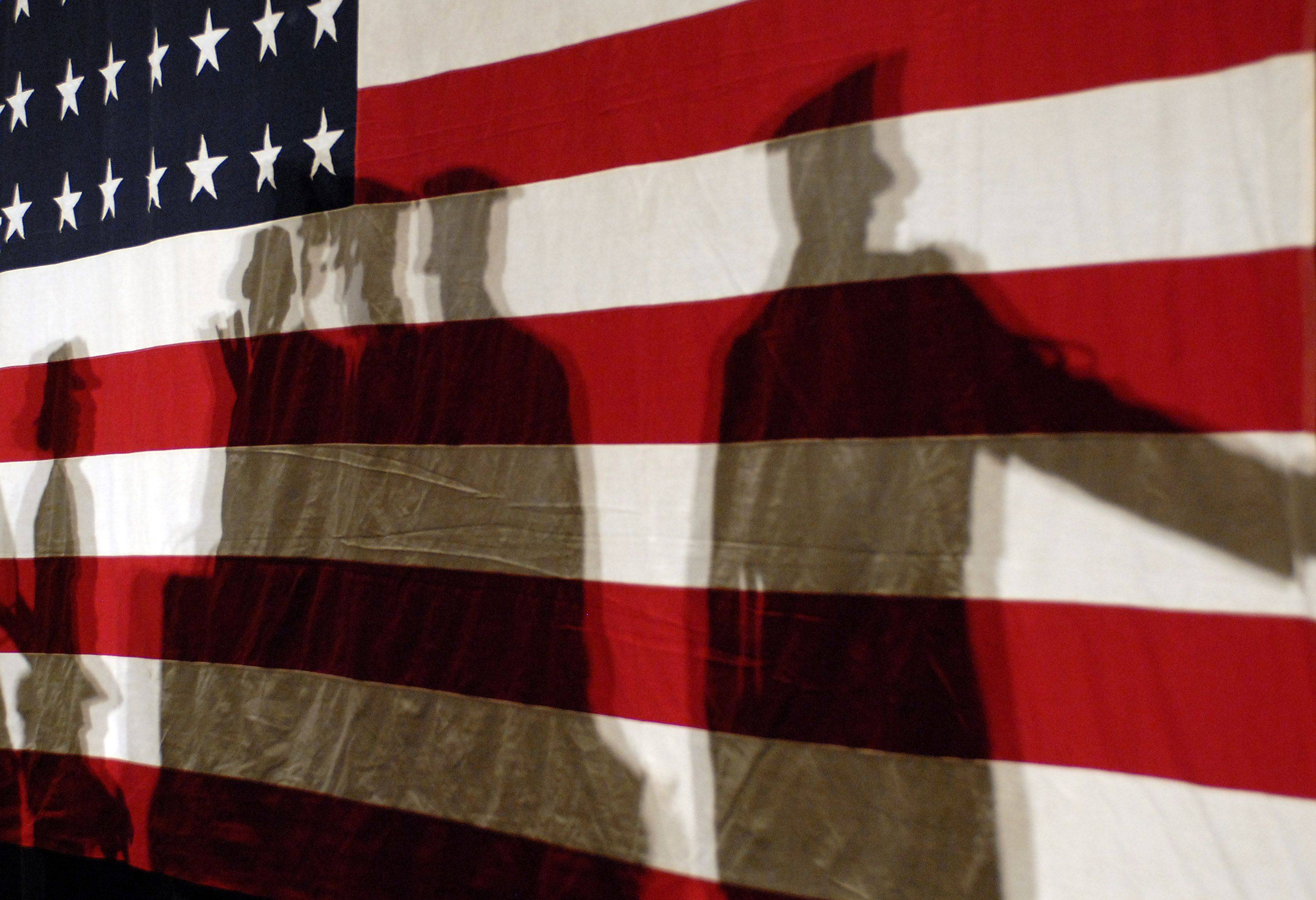 Shadows of the Zion-Benton ROTC soldiers highlight a WWII 48 star flag which was used as a backdrop at Mark Kirk's campaign headquarters on election night.