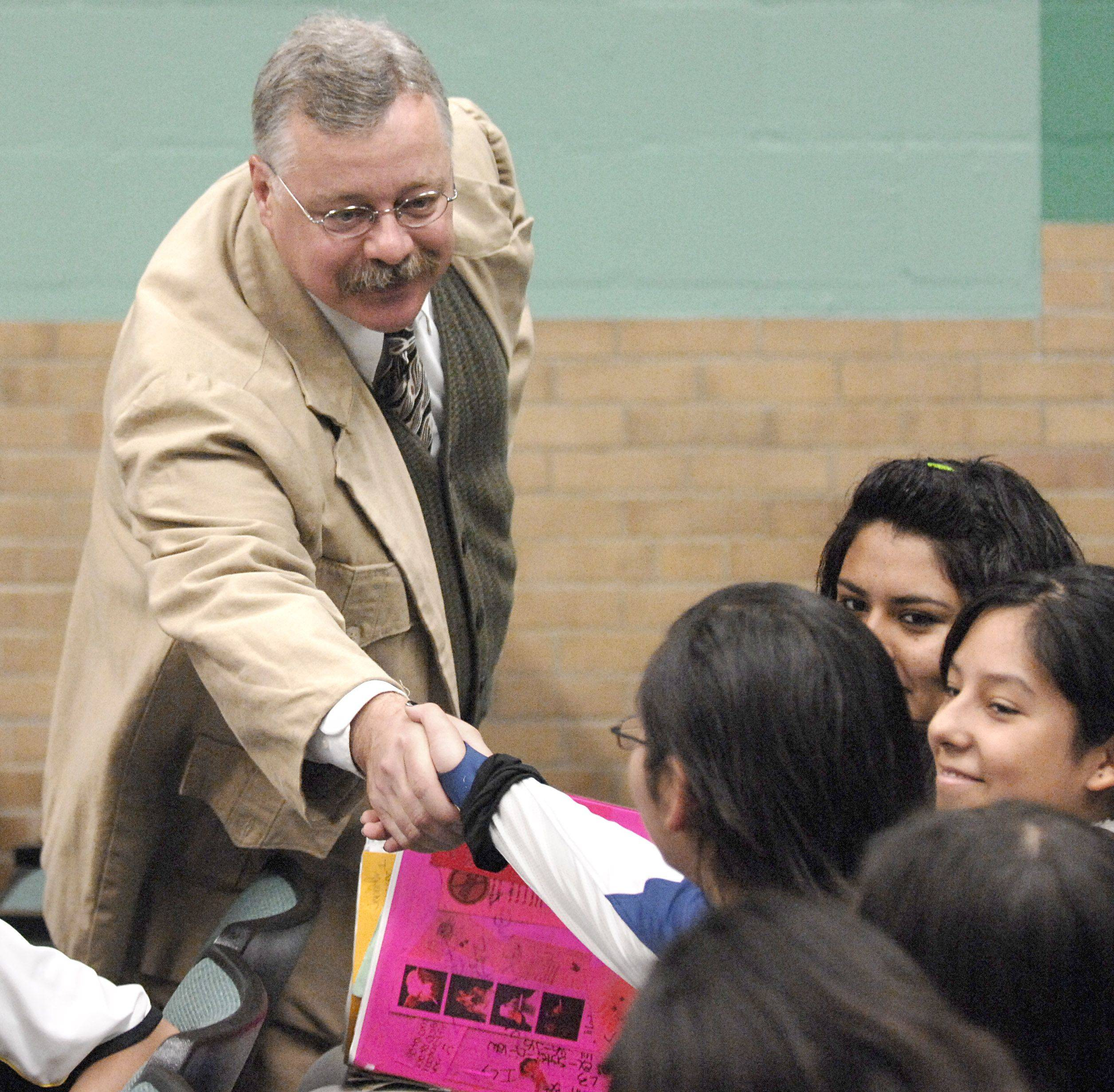 "Joe Wiegand, as President Theodore Roosevelt, does a meet and greet with eighth graders at Larsen Middle School in Elgin before his performance on Friday, November 5. Wiegand, who looks strikingly like Roosevelt, has been performing professionally as the former president for the past four years. He finds him, ""Such an amazing and rich character,"" and enjoys bringing him to life for his audiences. In 2008, he performed in all 50 states culminating in a performance at the White House. Wiegand will perform for the Elgin Area Historical Society Museum's fundraiser on Saturday at The Centre."