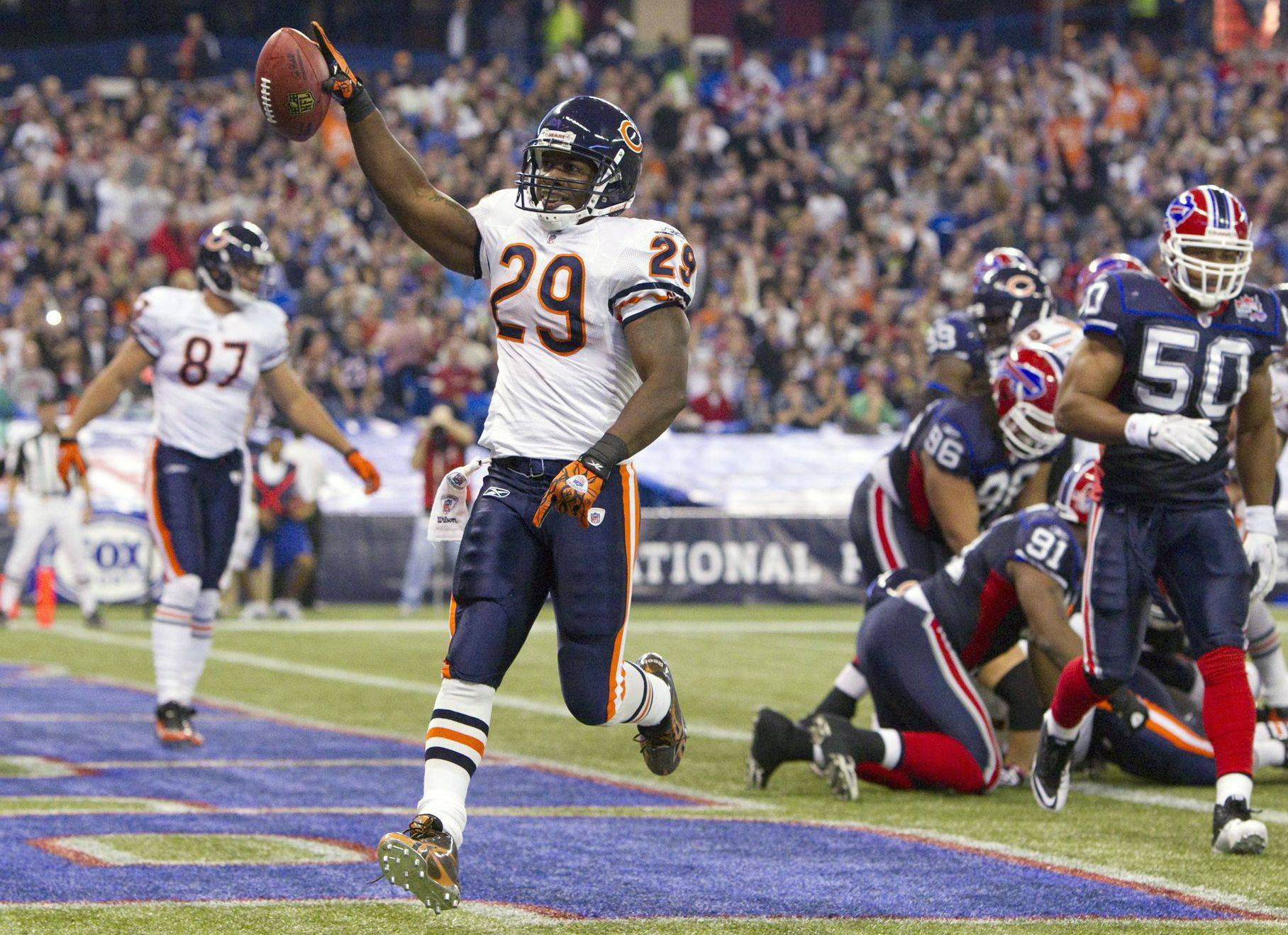 Chicago Bears' Chester Taylor celebrates a touchdown during second-half.