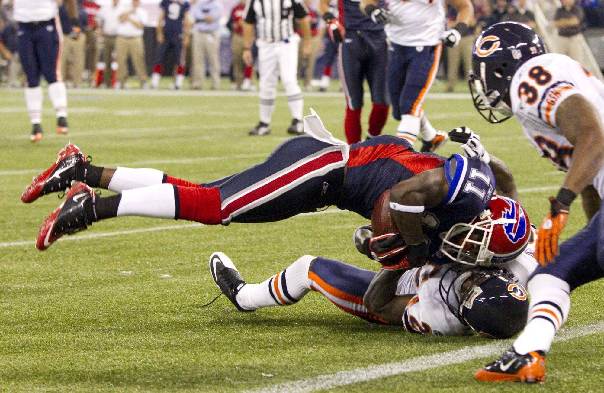 Buffalo Bills' Roscoe Parrish dives into the end zone for a touchdown as Chicago Bears' Tim Jennings attempts to make the tackle during first-half.