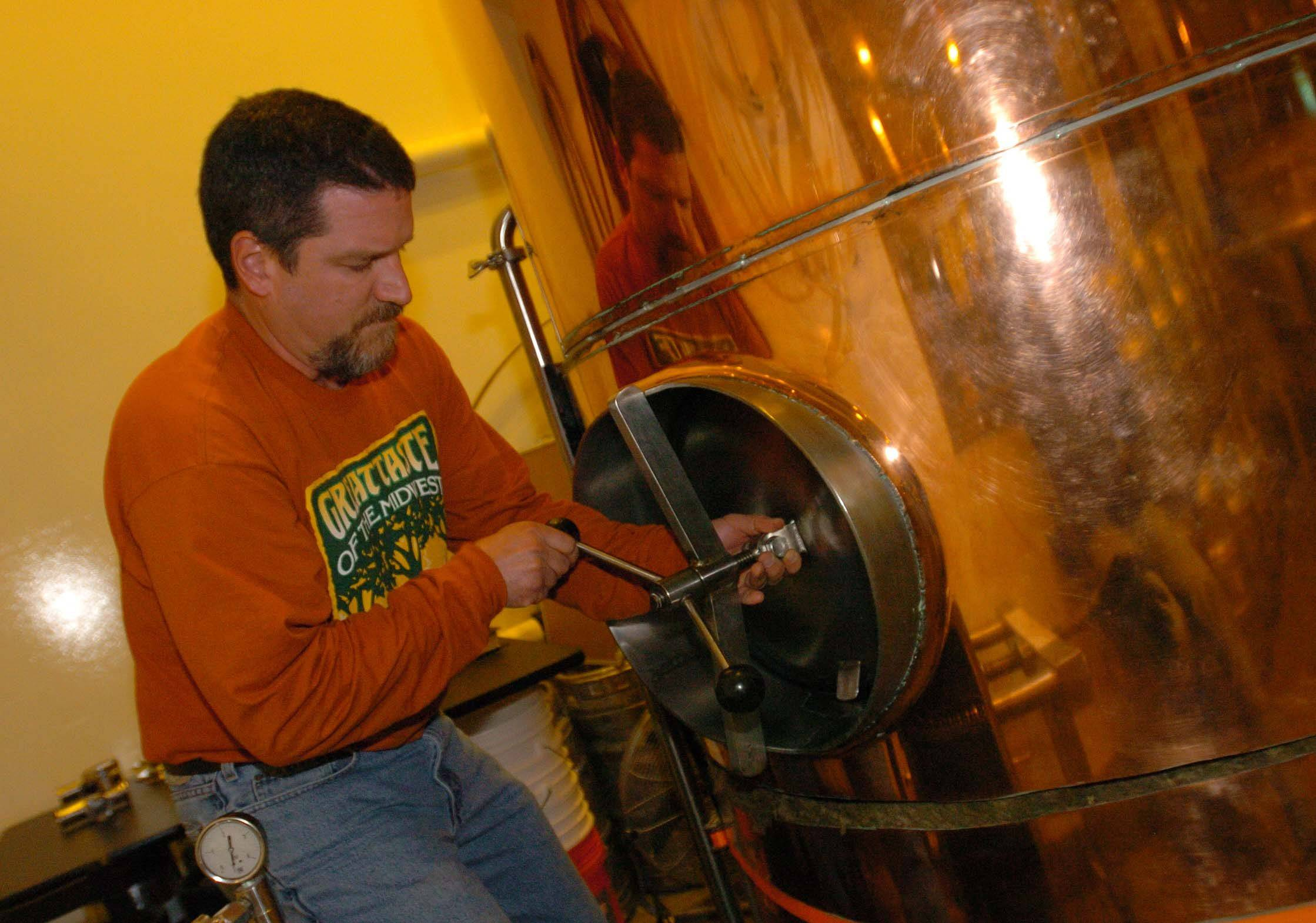 Brewmaster Ken McMullen checks on his craft beers at Limestone Brewery in Plainfield.