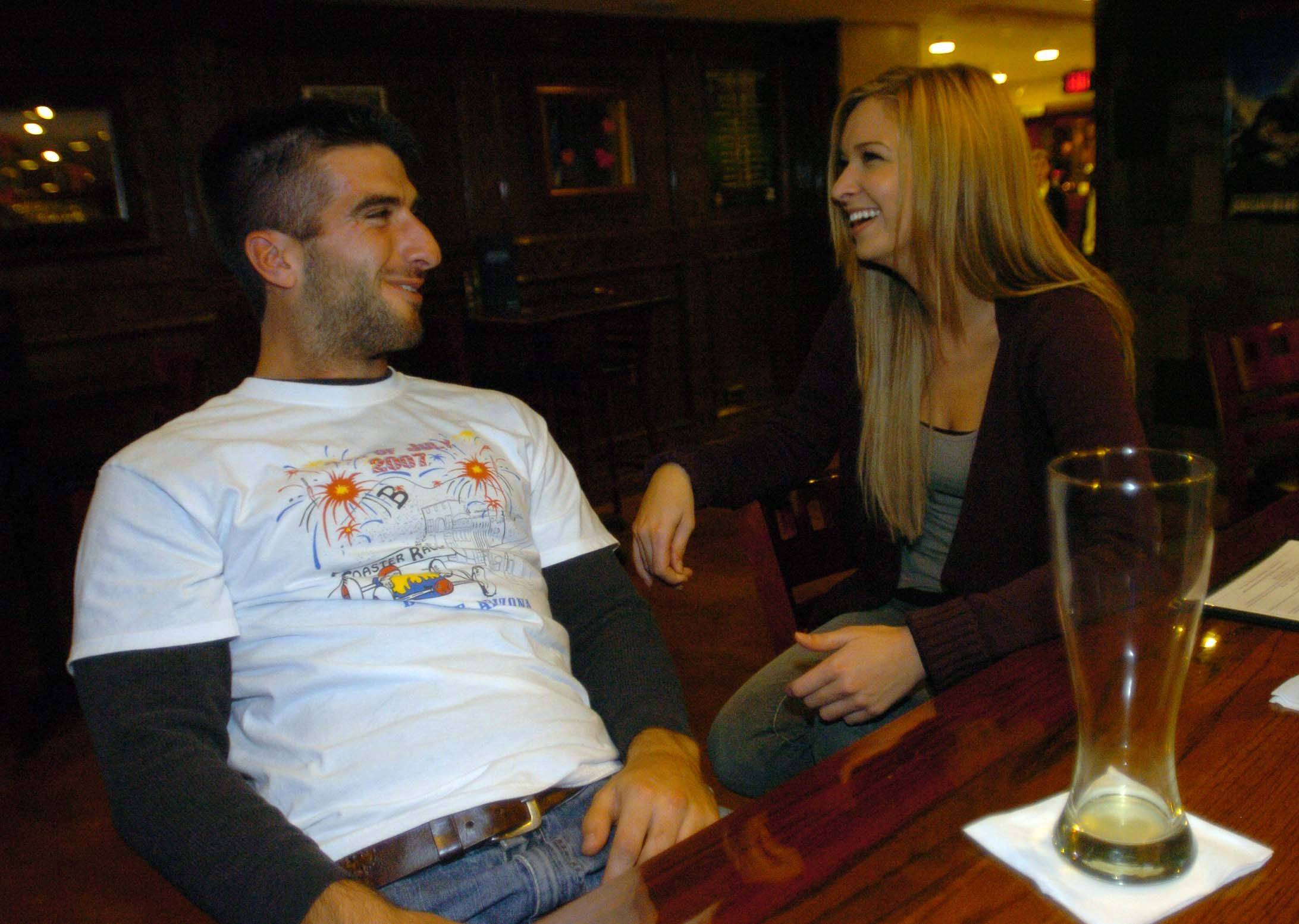 Micah Bank, left, and Jenni Marks talk over drinks at Limestone Brewery in Plainfield.