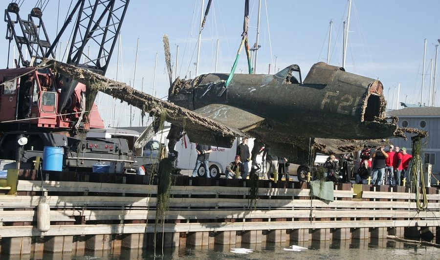 A World War II F4U-1 Corsair fighter plane was recovered from Lake Michigan Monday by A&T Recovery at Larsen Marine at Waukegan Harbor. The Corsair, piloted by Ensign Carl Harold Johnson, crashed into the lake during training exercises in 1943.