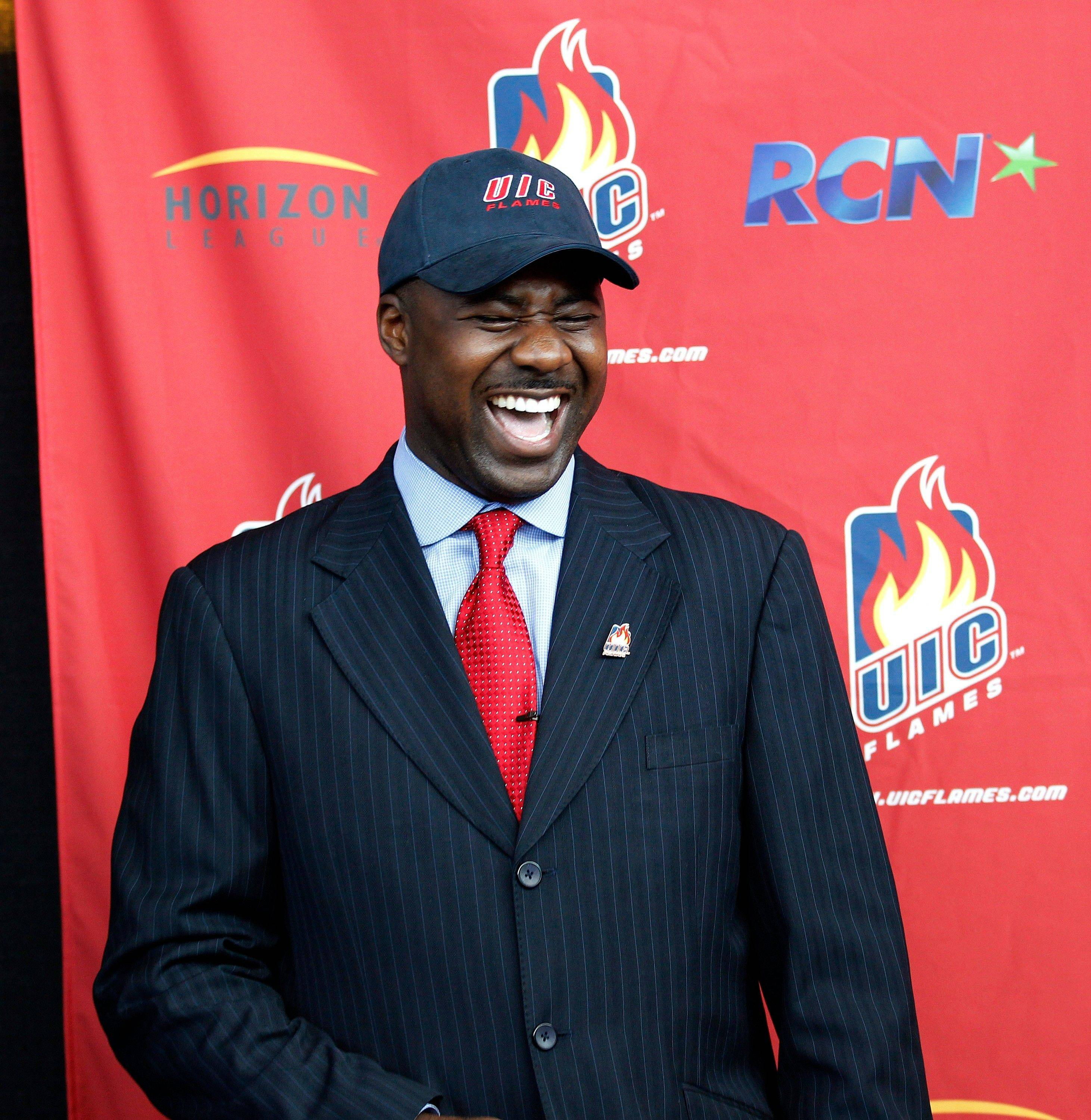 He has a smile here, but Howard Moore, the new men's basketball coach at UIC, likes his players to show plenty of grit and a level of toughness he learned while coaching at Wisconsin.