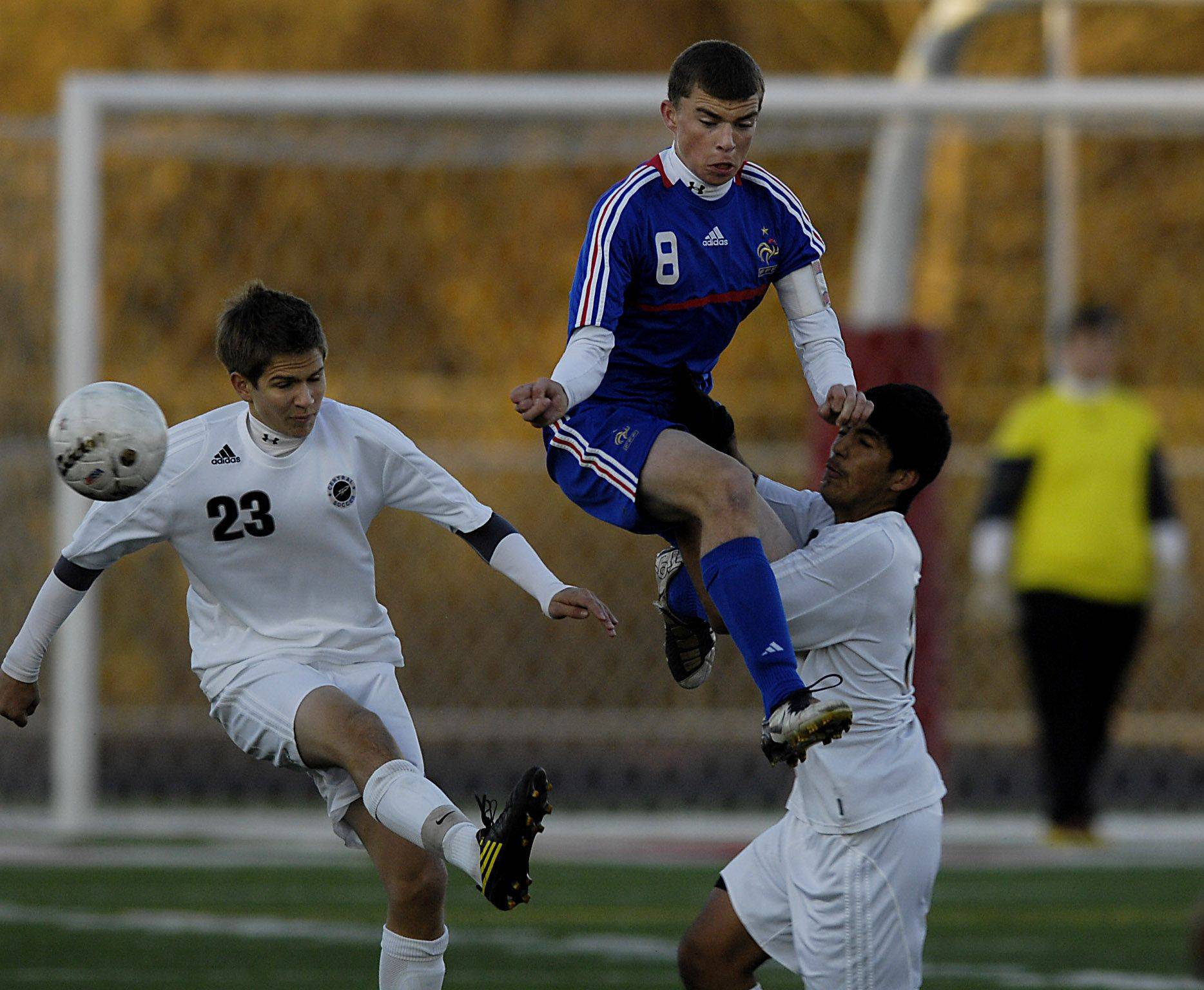 Lakes' Matt Dexheimer leaps between Burlington Central's Grant Stoneman and Alejandro Nava, right, in the Class 2A supersectional game in Barrington Tuesday night.