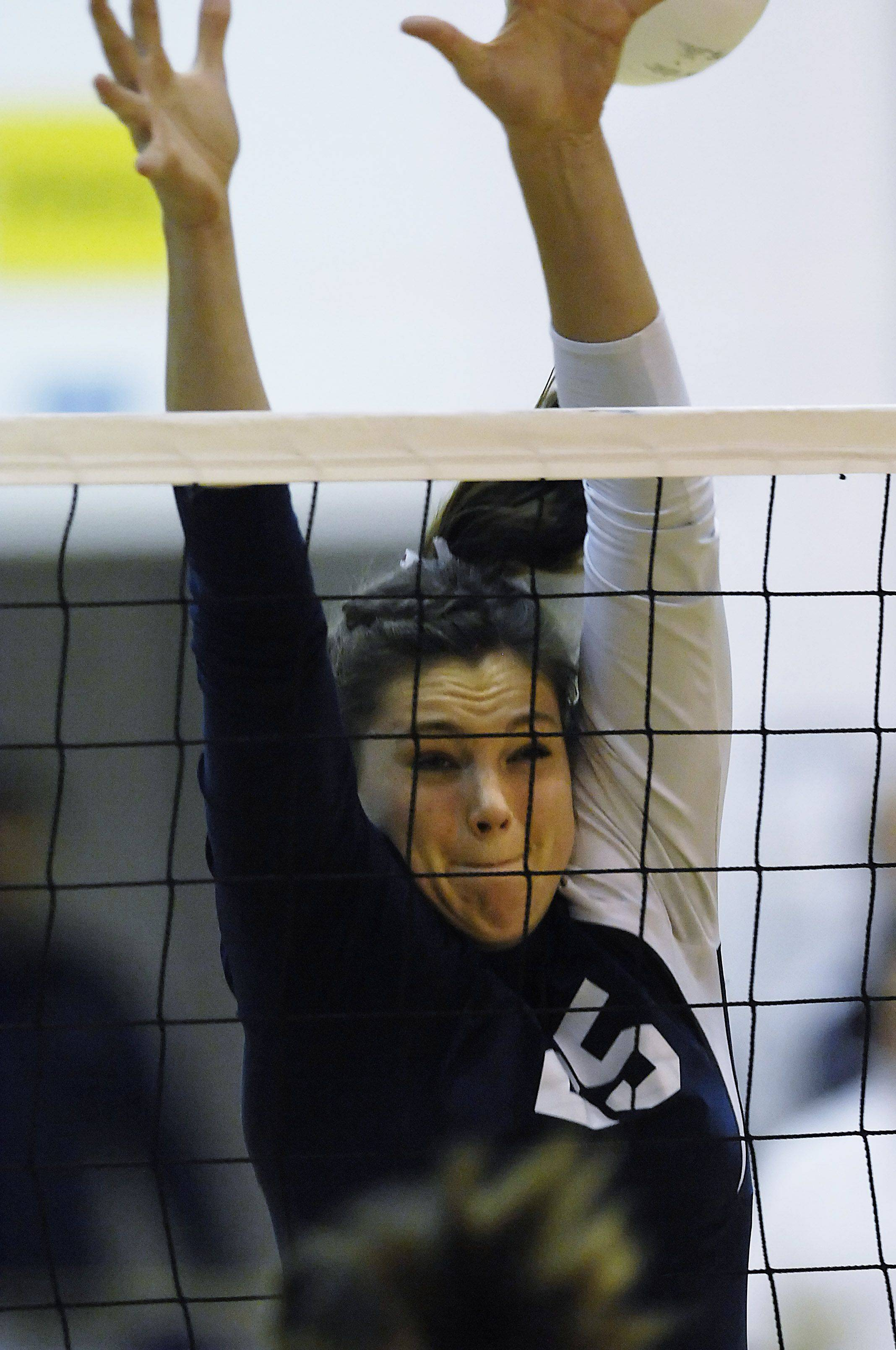 Cary-Grove's Ashley Rosch blocks against Hononegah Thursday in the Class 4A sectional championship in Algonquin.