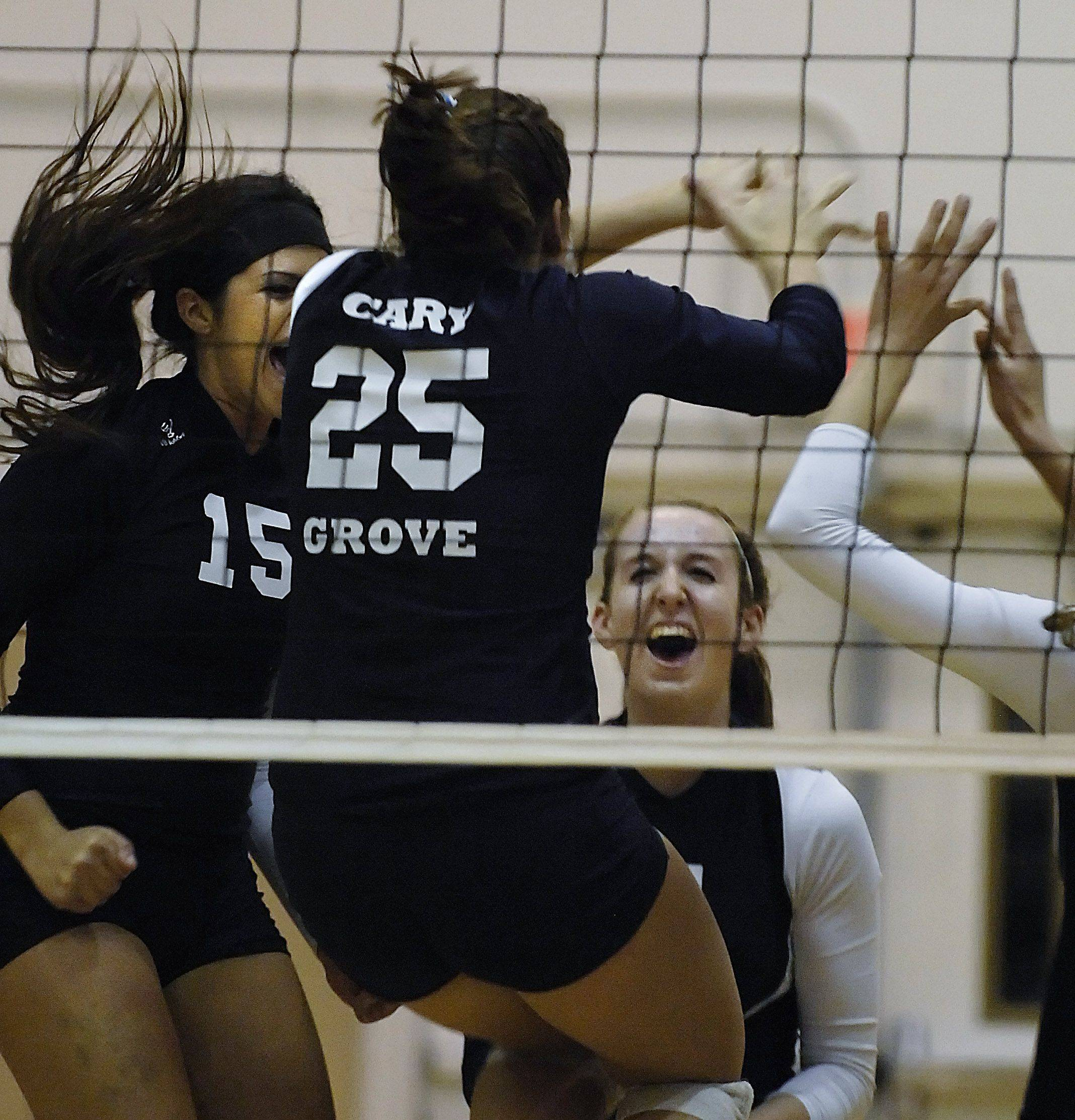 Cary-Grove celebrates a point against Hononegah Thursday in the Class 4A sectional championship in Algonquin.