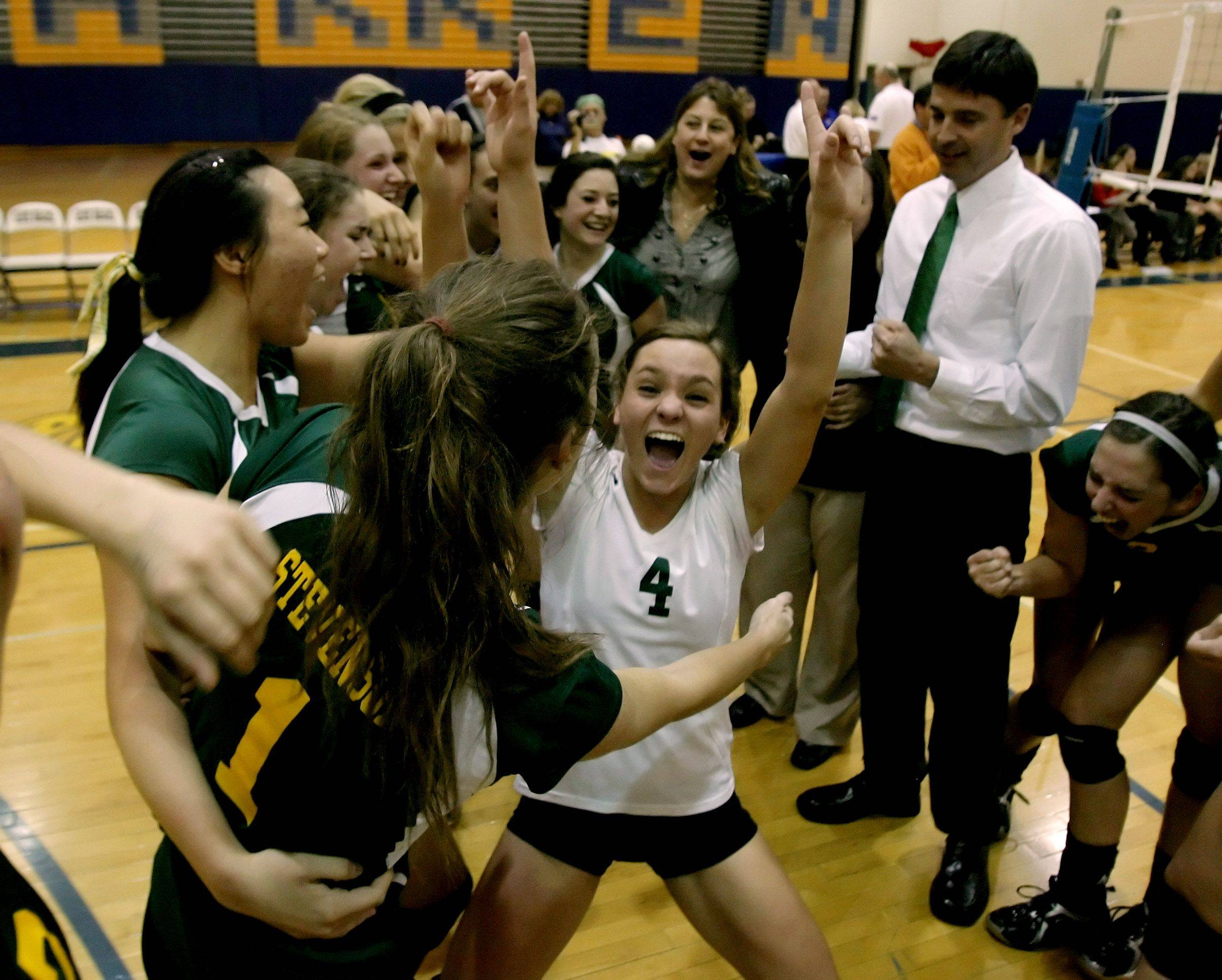 Nicole Duszczyk, center, celebrates with her Stevenson teammates after their victory over Lake Zurich in Thursday's sectional volleyball championship in Gurnee.