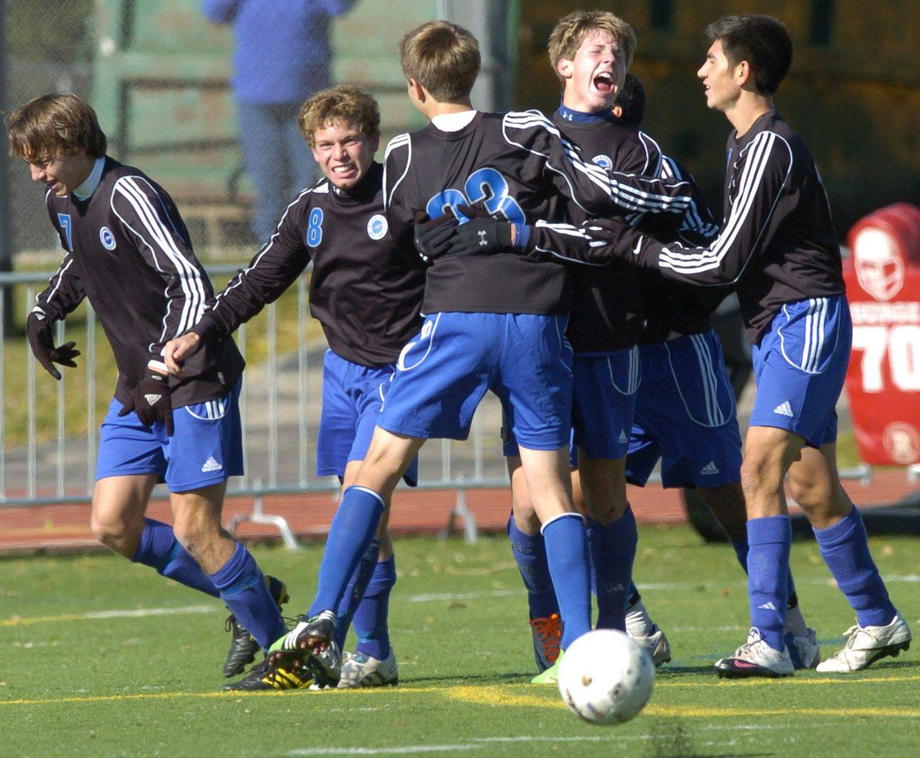 Burlington Central celebrates their goal during Friday's Class 2A state boys soccer semifinal.