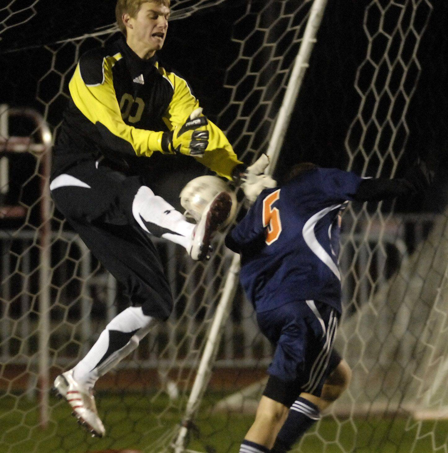 Libertyville goalkeeper Andrew Bitta beats Naperville North's Joe Sullivan to a ball in the box during Friday's 3A state soccer semifinals at North Central College in Naperville.