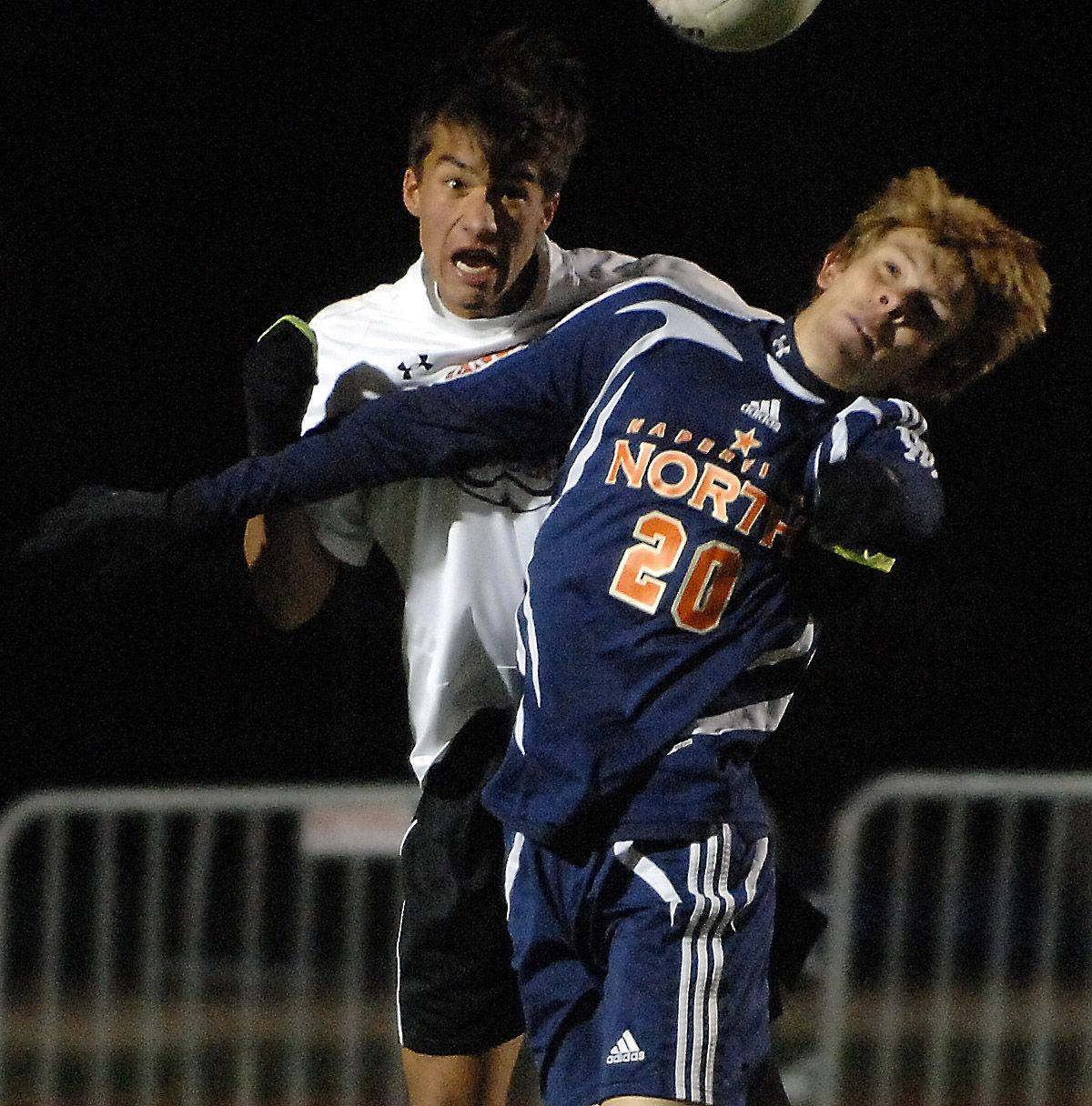 Naperville North's Lee Grander and Libertyville's Landon Eyre battle for a header during Friday's 3A state soccer semifinals at North Central College in Naperville.