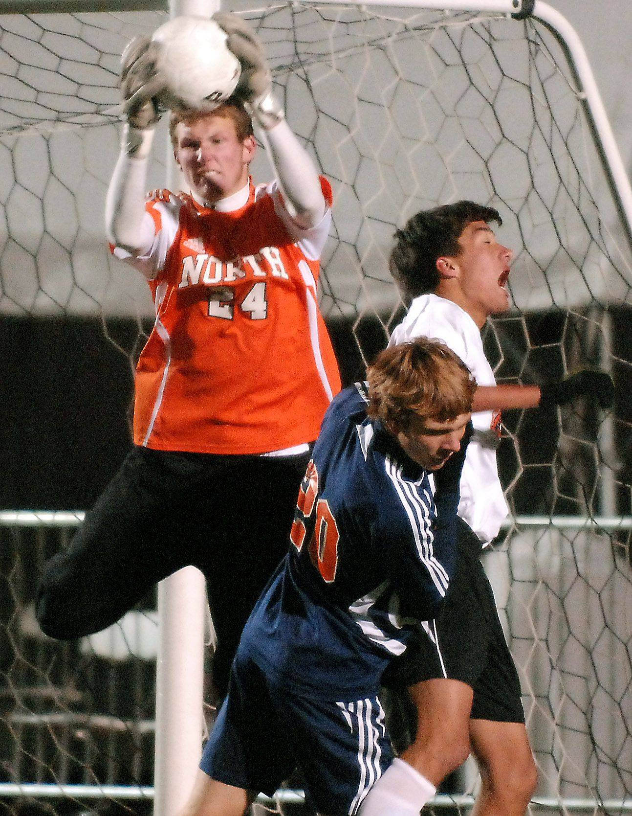 Naperville North goalkeeper Kevin Anderson wins a crossed ball during Friday's 3A state soccer semifinals at North Central College in Naperville.