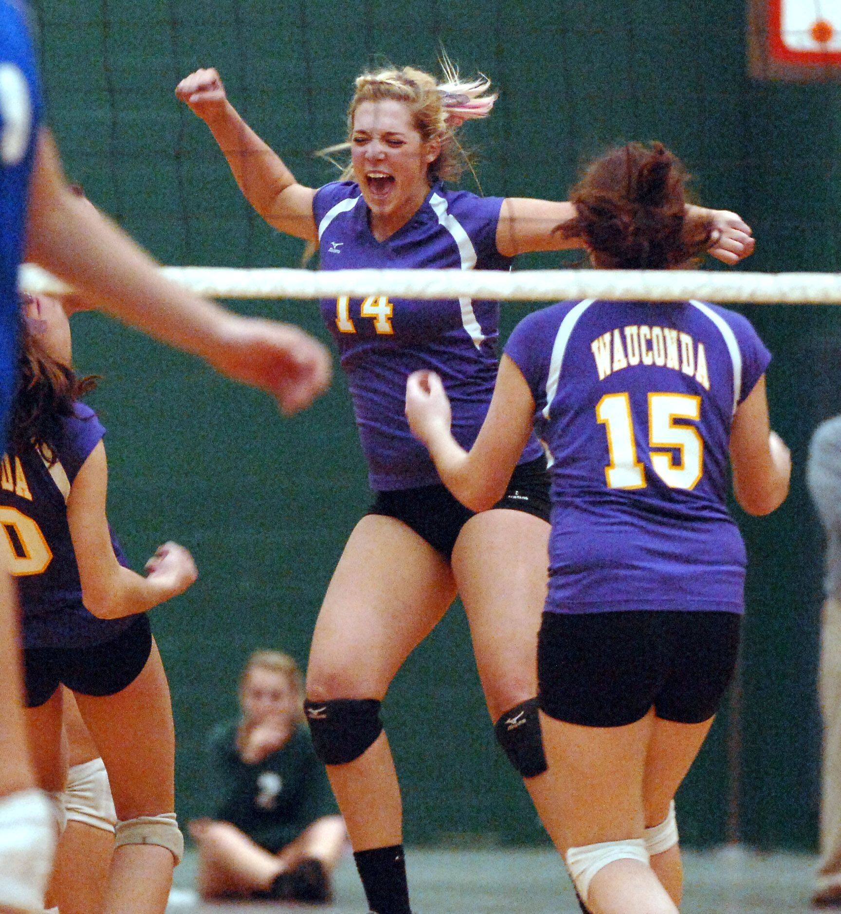 Wauconda's Erinn Hellweg, 14, celebrates a point with teammate Emily Holub, 15, during their sectional match against Vernon Hills Tuesday in Grayslake.
