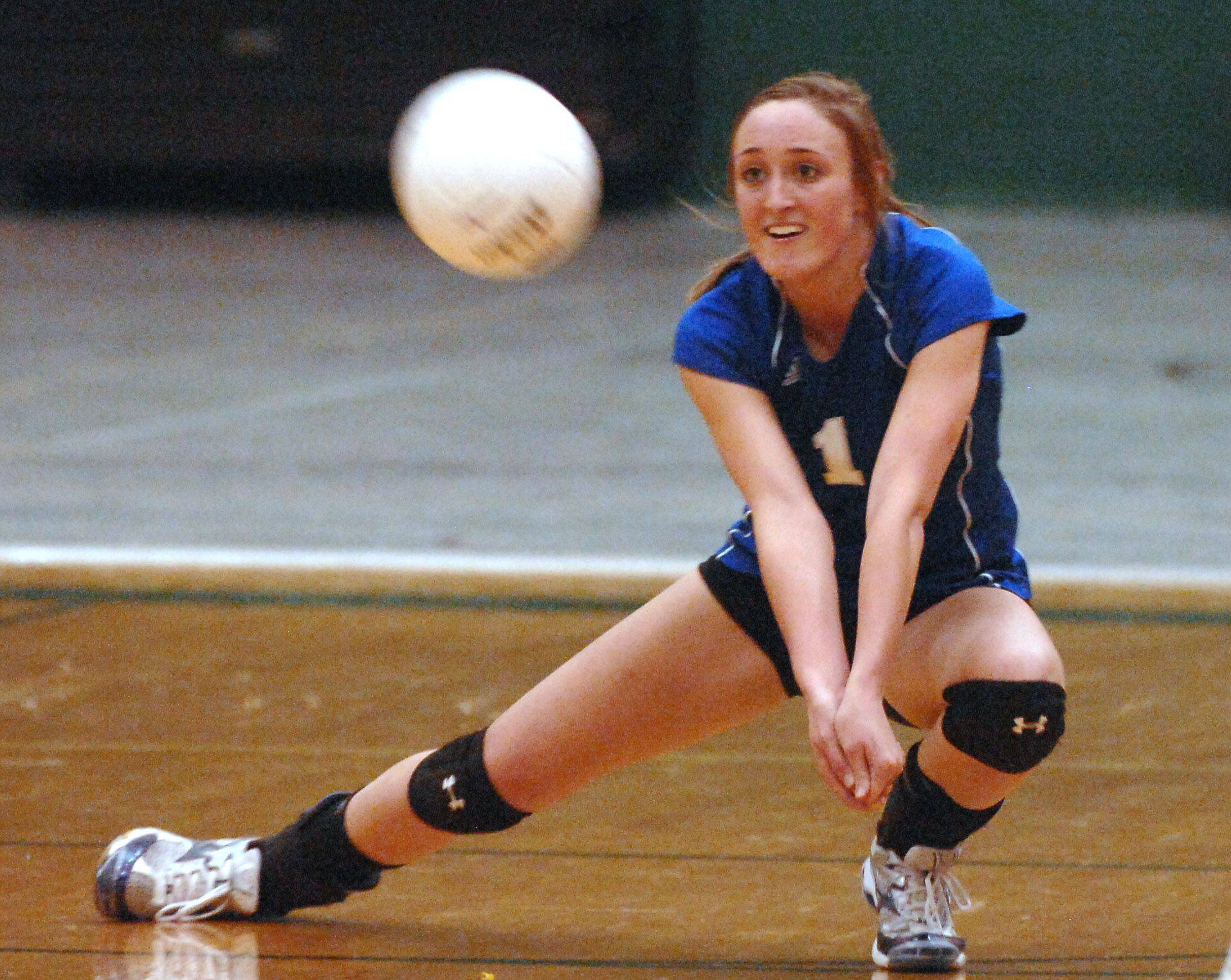 Vernon Hills' Alisa Welter makes a dig against Wauconda during the sectional volleyball match in Grayslake Tuesday.