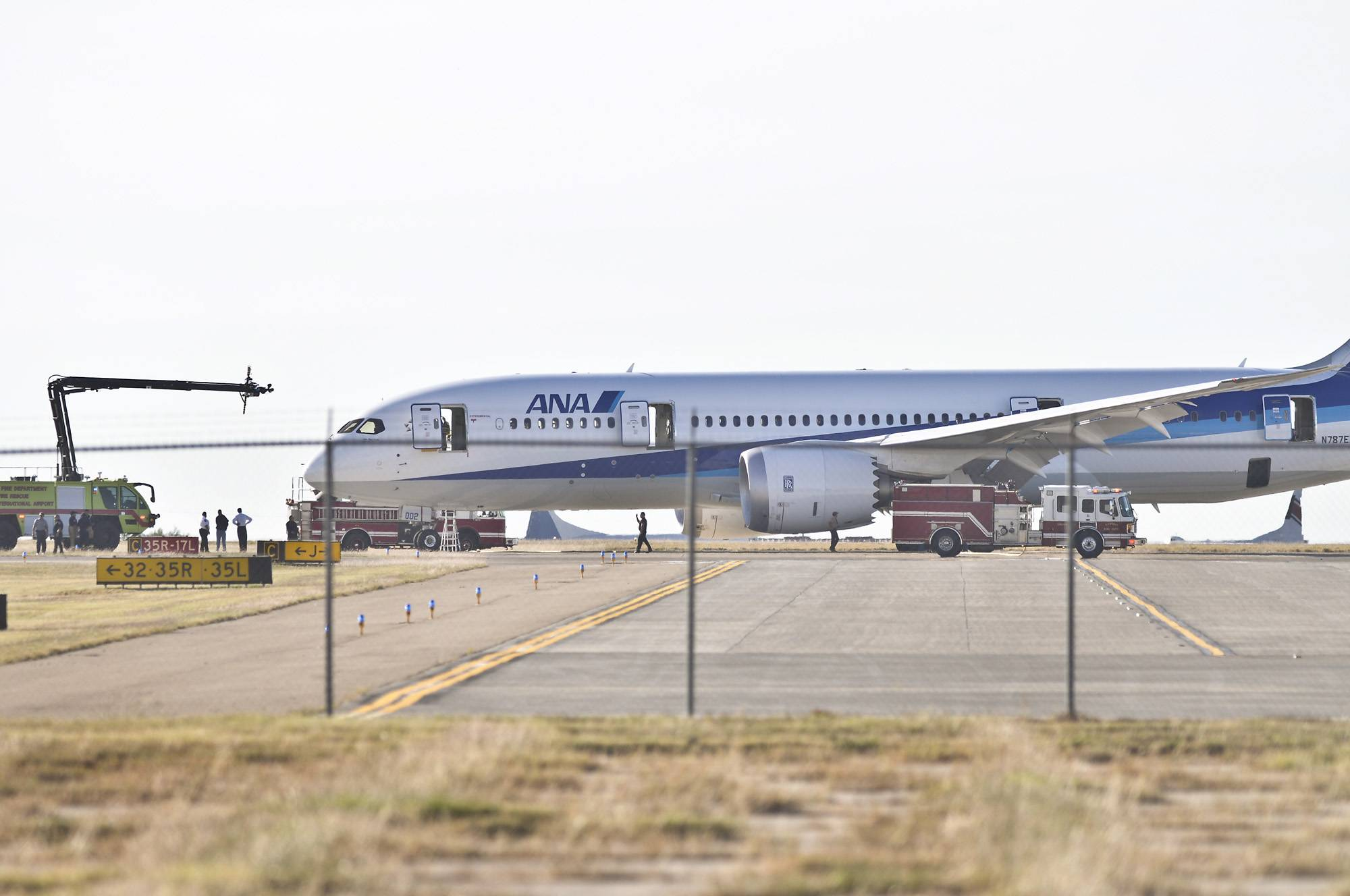 Firefighters and airport officials investigate the scene of an incident involving a Boeing 787 jetliner at the Laredo International Airport Tuesday.