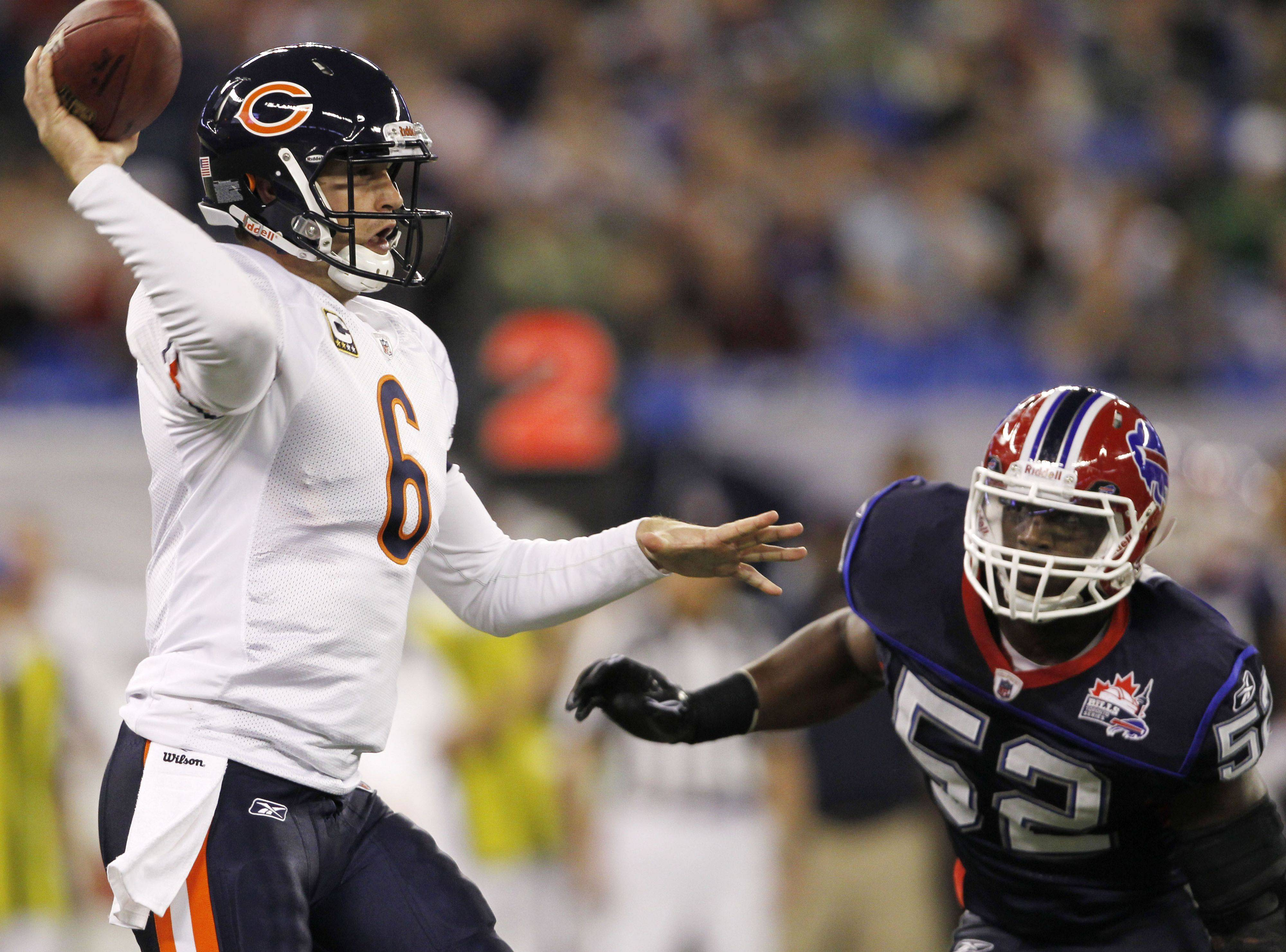 Buffalo Bills' Arthur Moats (52) pressures Chicago Bears' quarterback Jay Cutler (6) during the first half of an NFL football game at the Rogers Centre in Toronto, on Sunday, Nov. 7, 2010.