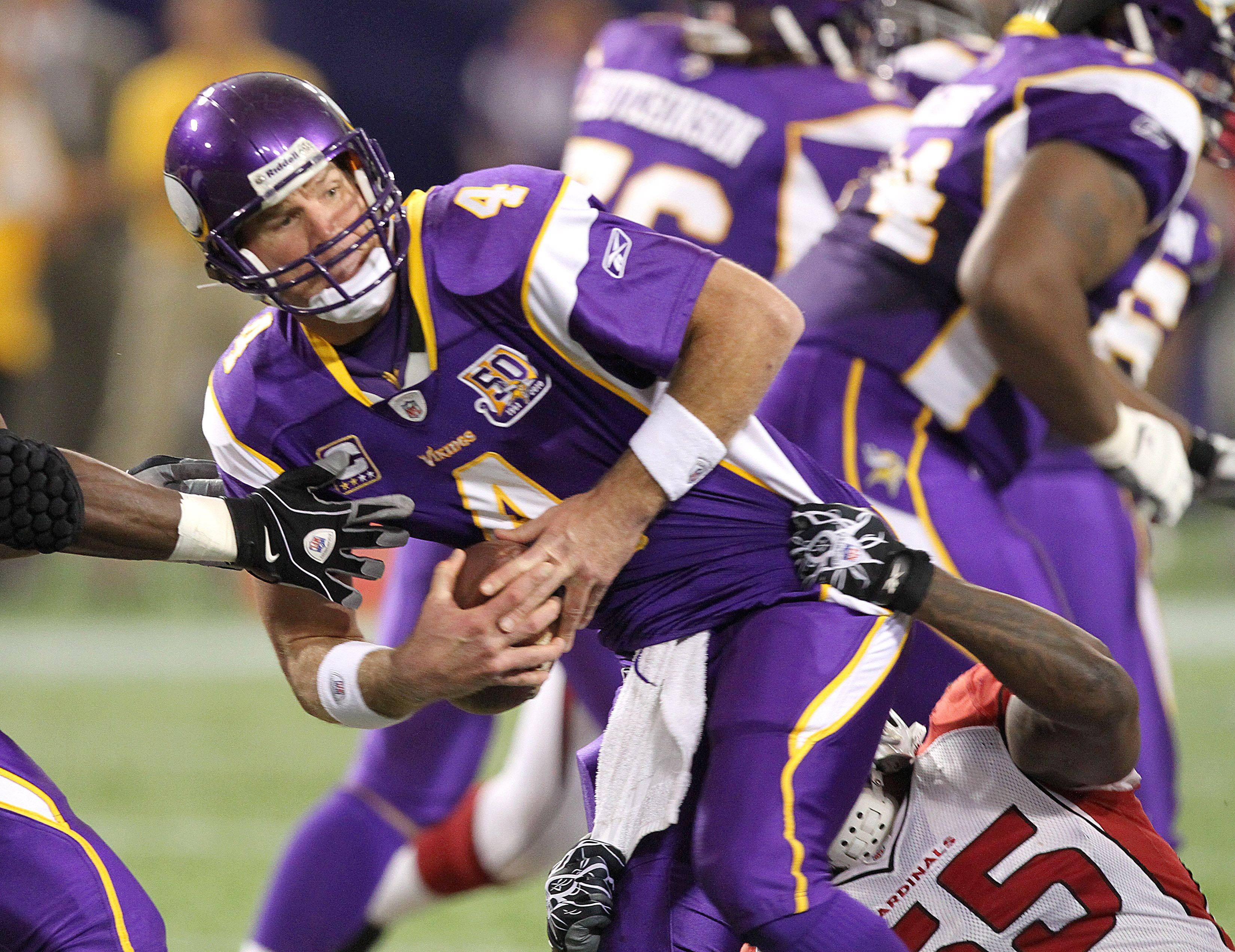 Minnesota Vikings quarterback Brett Favre (4) is sacked by Arizona Cardinals linebacker Joey Porter (55) in the first quarter of their NFL football game in Minneapolis, Sunday, Nov. 7, 2010.
