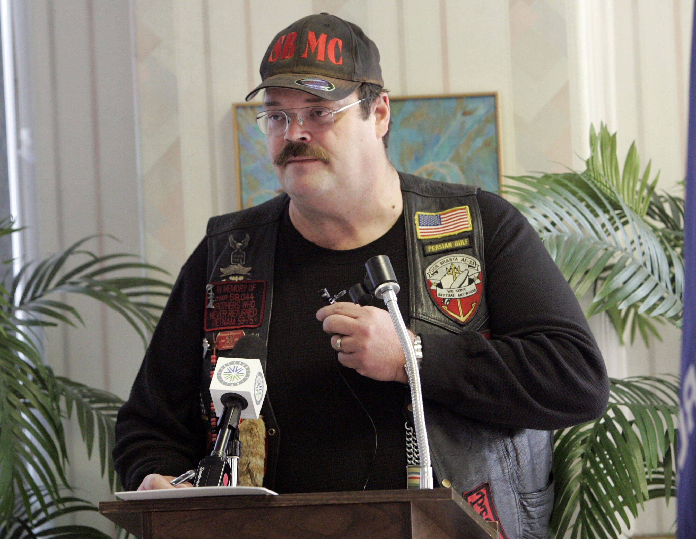 Glen Rabanos of Hainesville says a few words as members of the Second Brigade Motorcycle Club sponsored a breakfast for veterans at Winchester House in Libertyville Thursday.