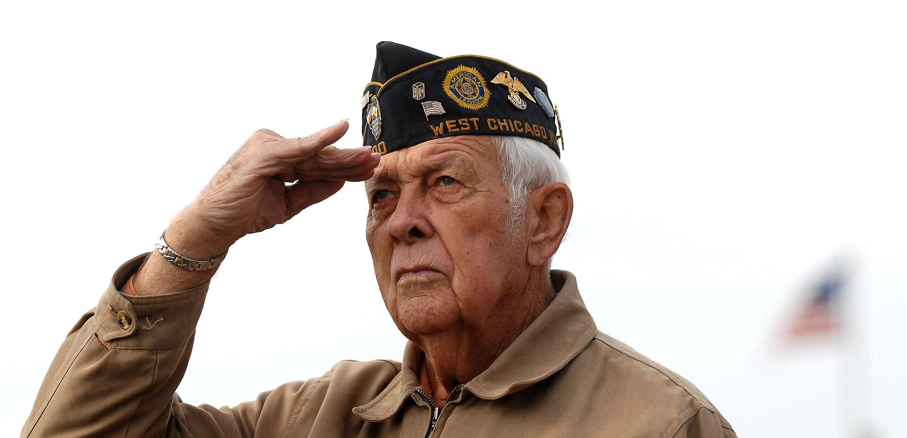 U.S. Army veteran Gordon Dierschow of Elburn salutes during the Elburn Veteran's Day ceremony Thursday.