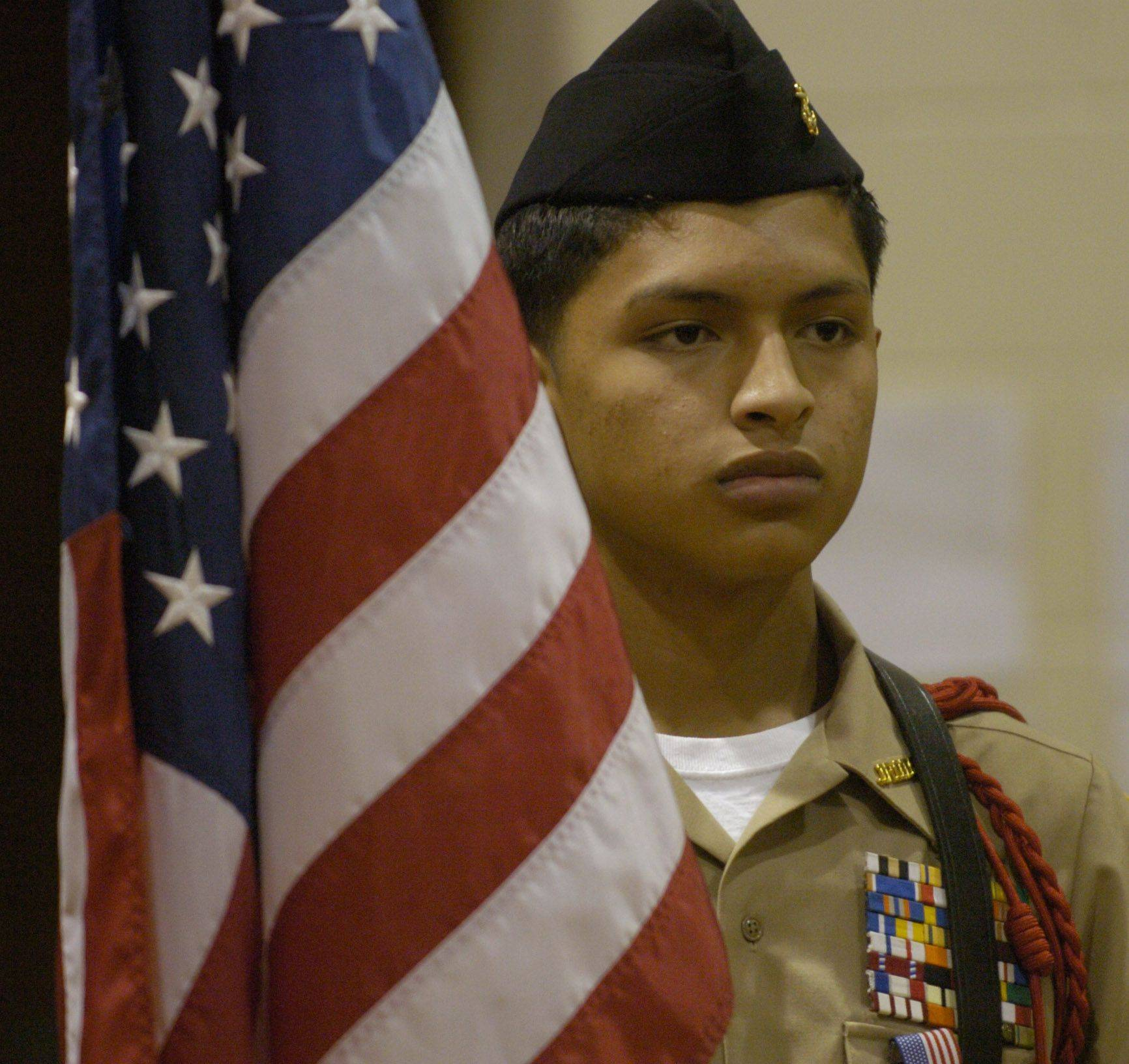 Sophomore George Alvarez of the Wheeling High School NJROTC color guard, stands at attention with the flag before a Veteran's Day event at MacArthur Middle School, Prospect Heights, Thursday.